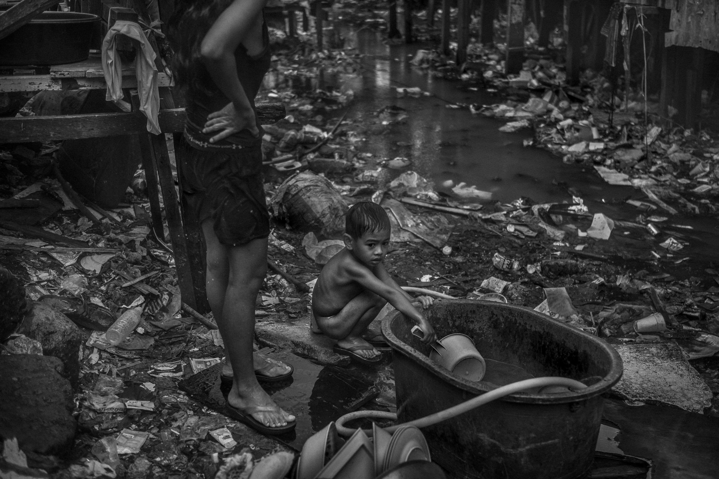 A young boy takes a bath in Estero de Magdalena.
