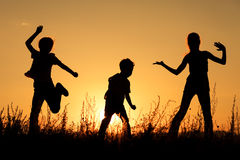 happy-children-playing-park-sunset-time-61543188.jpg