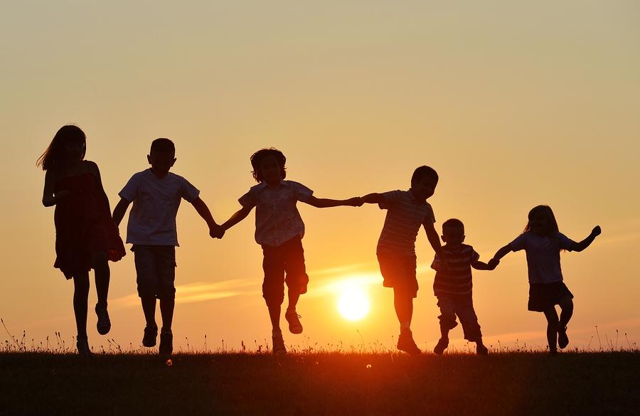 bigstock-Happy-children-silhouettes-on-63292741.jpg