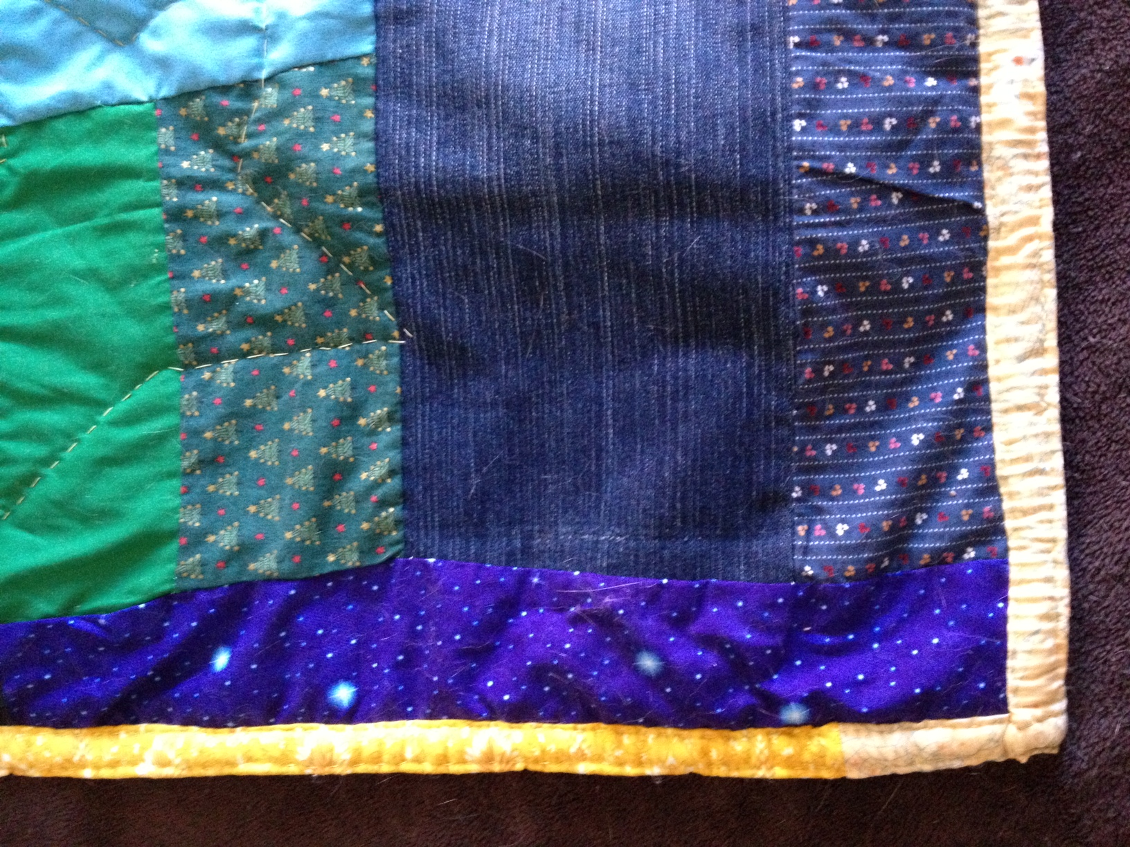 A corner of the first quilt I made. Cat hair: no extra charge.