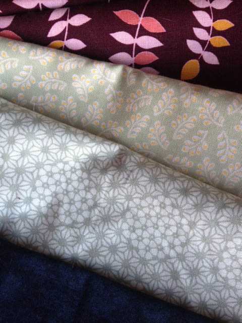 Always room for more fat quarters in lovely prints! The maroon on top is actually a oversized yard that I plan to use as a quilt back one day.