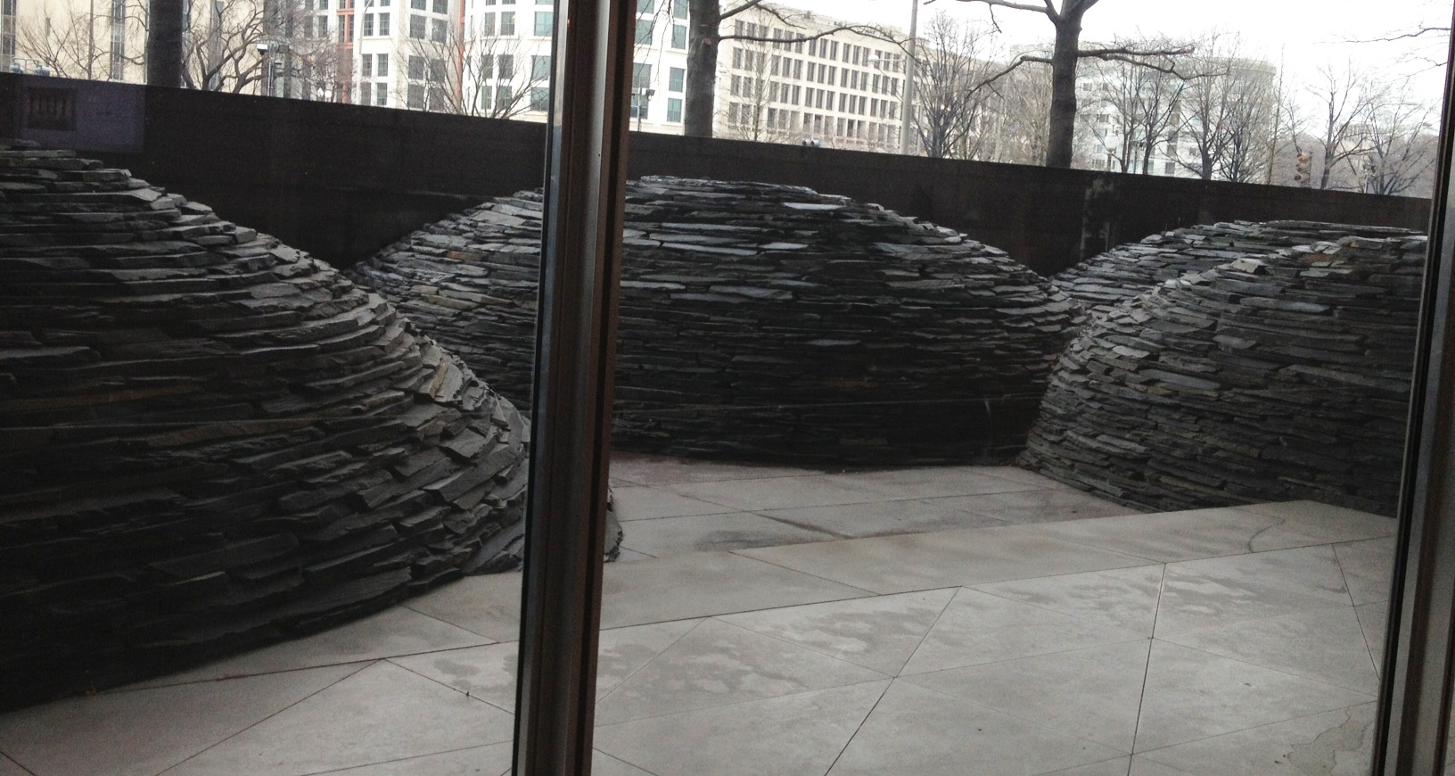 It's pretty rare to find Goldsworthy's work in galleries or museums. I always feel lucky if I stumble onto it. Unfortunately you could get no closer to it than this as the doors out to the patio were locked and the windows to look down on it were very dirty.