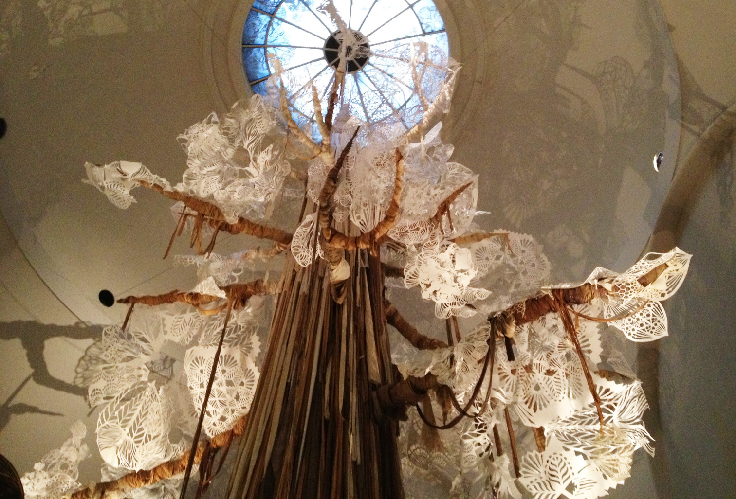 This giant tree created from paper mache, dyed fabric and paper cuts, was the center of the Swoon exhibit and served as a dock for two hand made  boats from a previous art piece.
