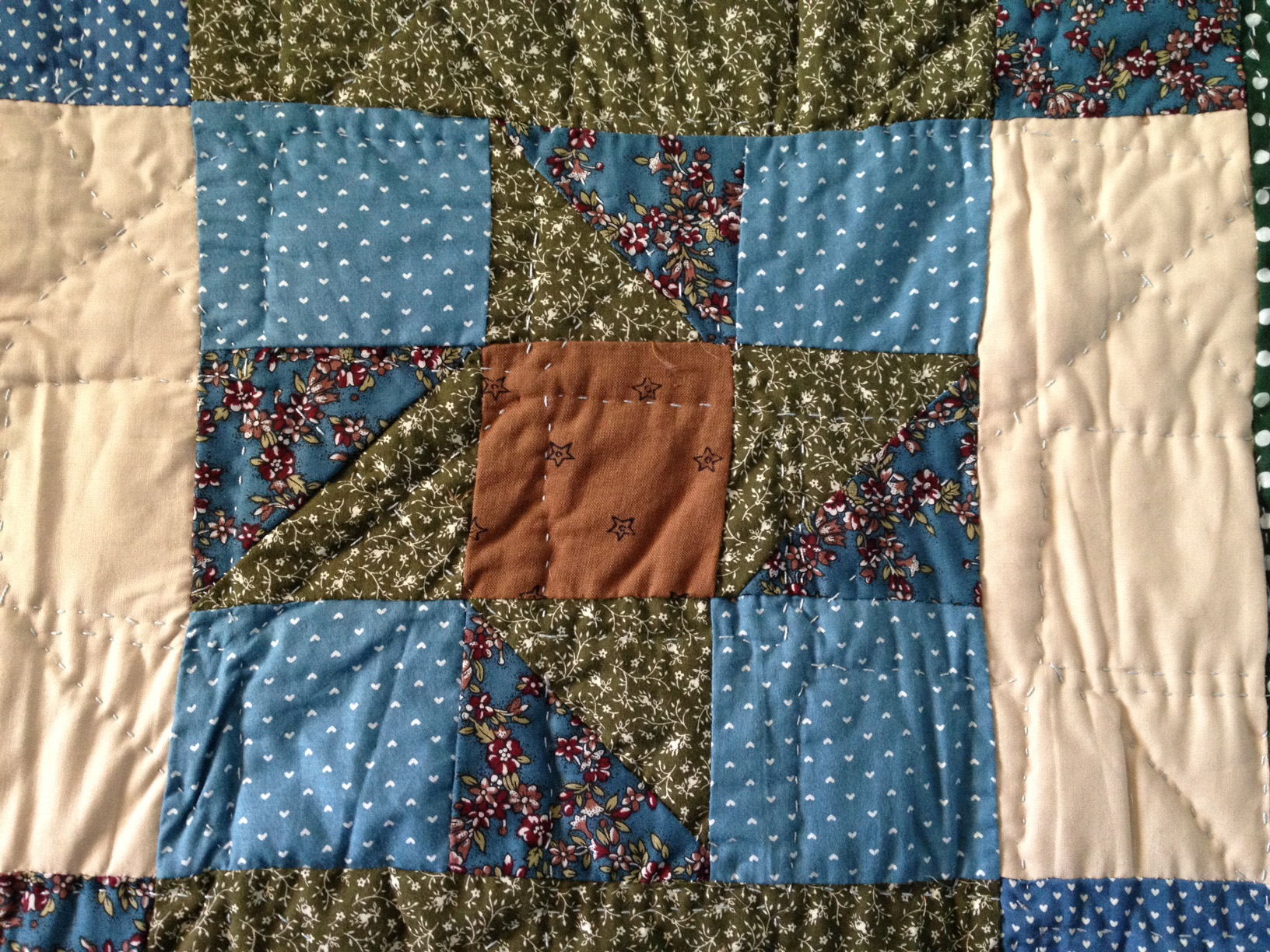 The quilting on the back doesn't match up with the back star, but still makes for an interesting design.