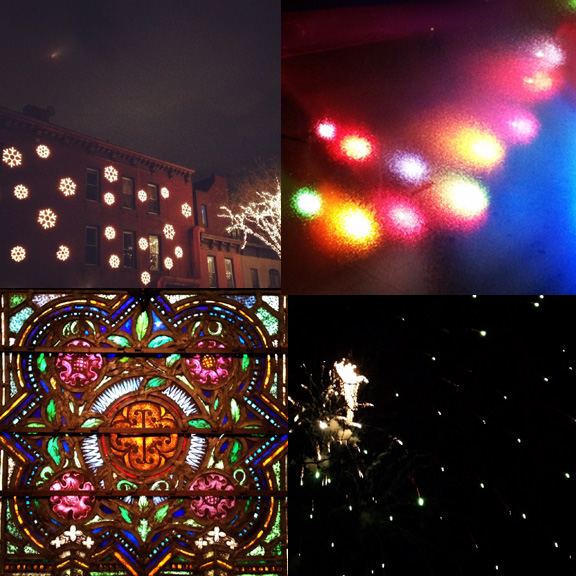 1) Lights on the houses, lights in the sky. 2) Cold and festive. 3) Welcoming light in. 4) Nighttime, last of the year.