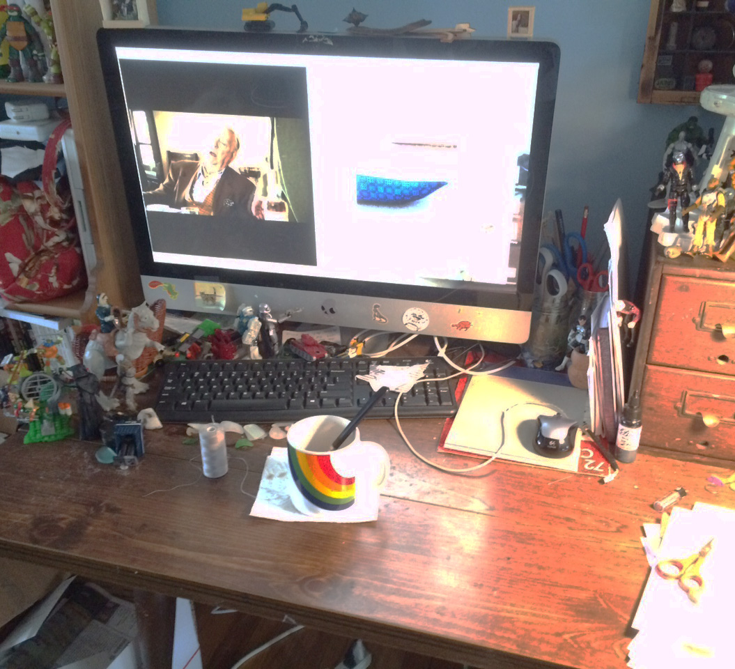 My workspace in all it's messy glory. Please note TMNT, Destro, tauntaun, sand, thread, coffee, tattoo ink, scissors, scissors, scissors, British comedy, Library Card boxes, curio cabinet, Bossk, Captain Picard, sea glass, and more....
