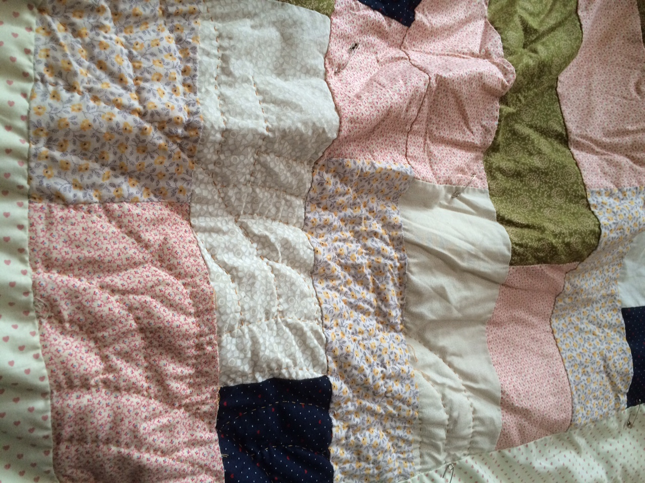 This big quilt gets all wrinkled from quilting in my lap. I don't use a hoop or frame.