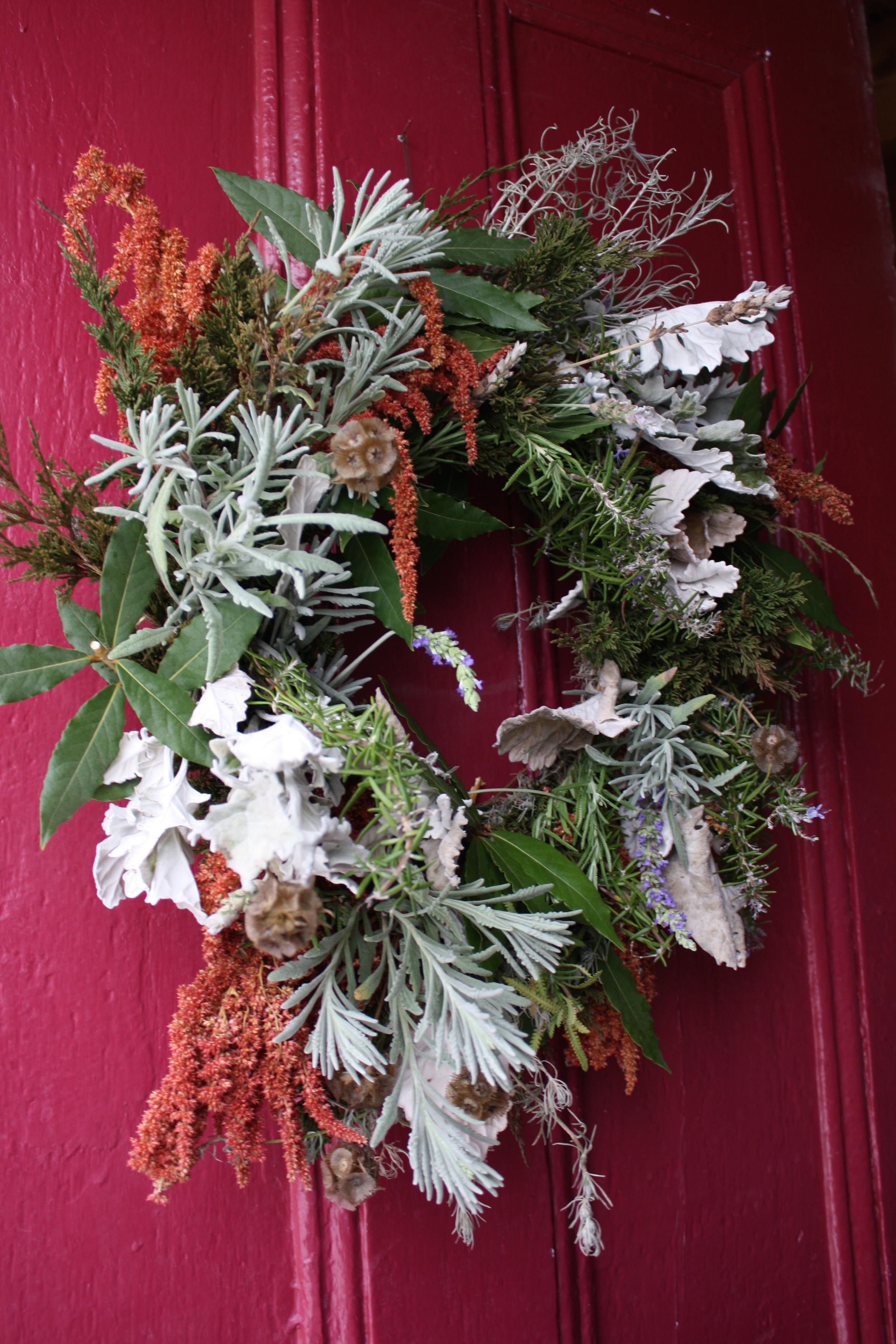 Bay Laurel, fresh lavender, prostrate rosemary, juniper, dried amaranth, dried dusty miller, dried ornamental curry, scabiosa pods