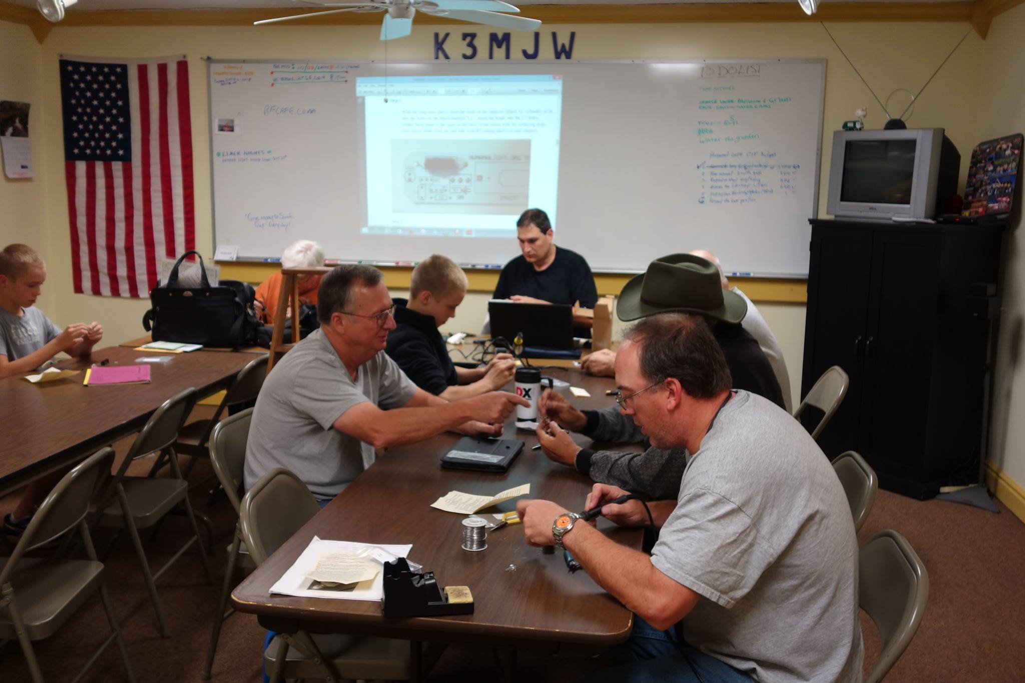 "Some of the members of Skyview Radio Society soldering their HumanaLight projects during Skyview Radio Society's ""Solder Smoke Elmer Night."" (Photo Credit: Bob Bereit, K3RMB)"