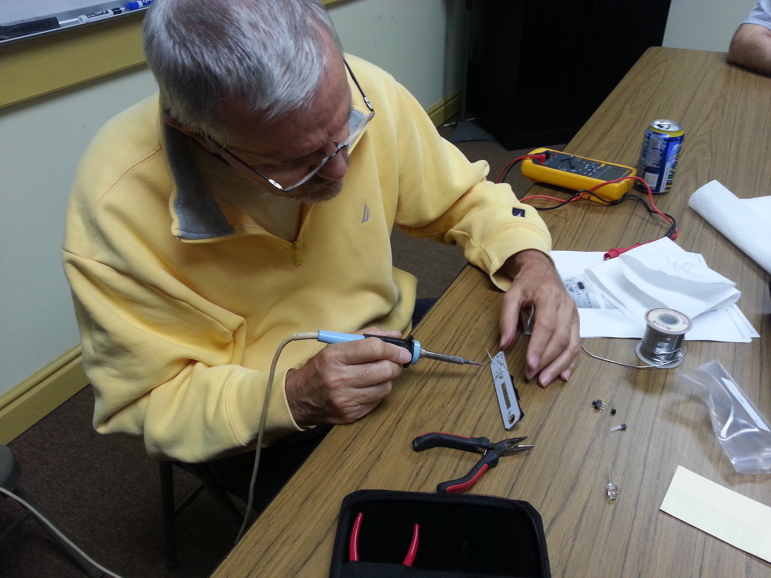 Jim, KQ3S, soldering his HumanaLight project. (Photo Credit: John Hoffman K3STL)