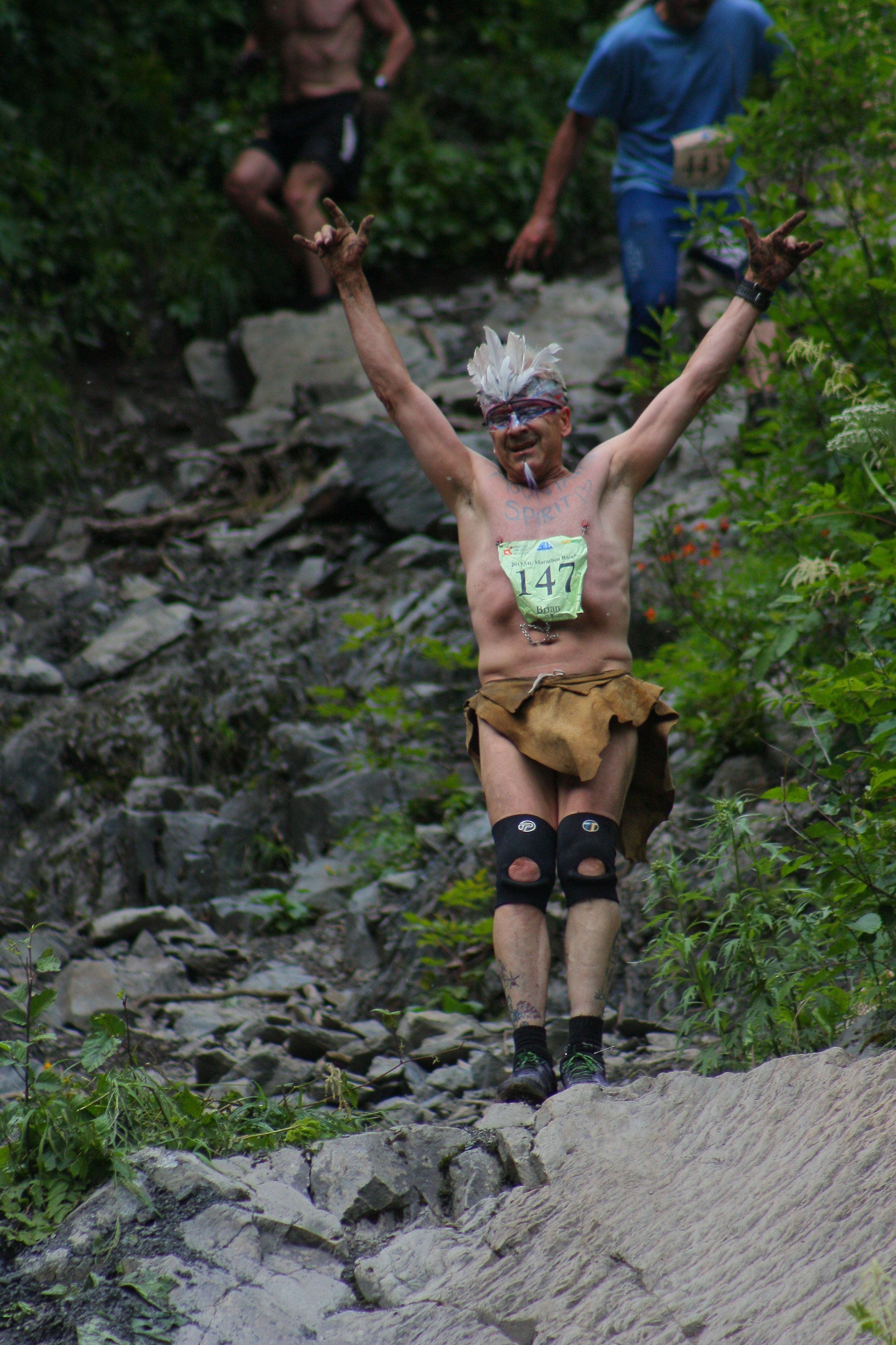 Anchorage mountain runner Brian Stoecker, known to many as 'Birdman', poses for the crowd in his characteristic loincloth and feather headpiece during the 2017 Mount Marathon Race.