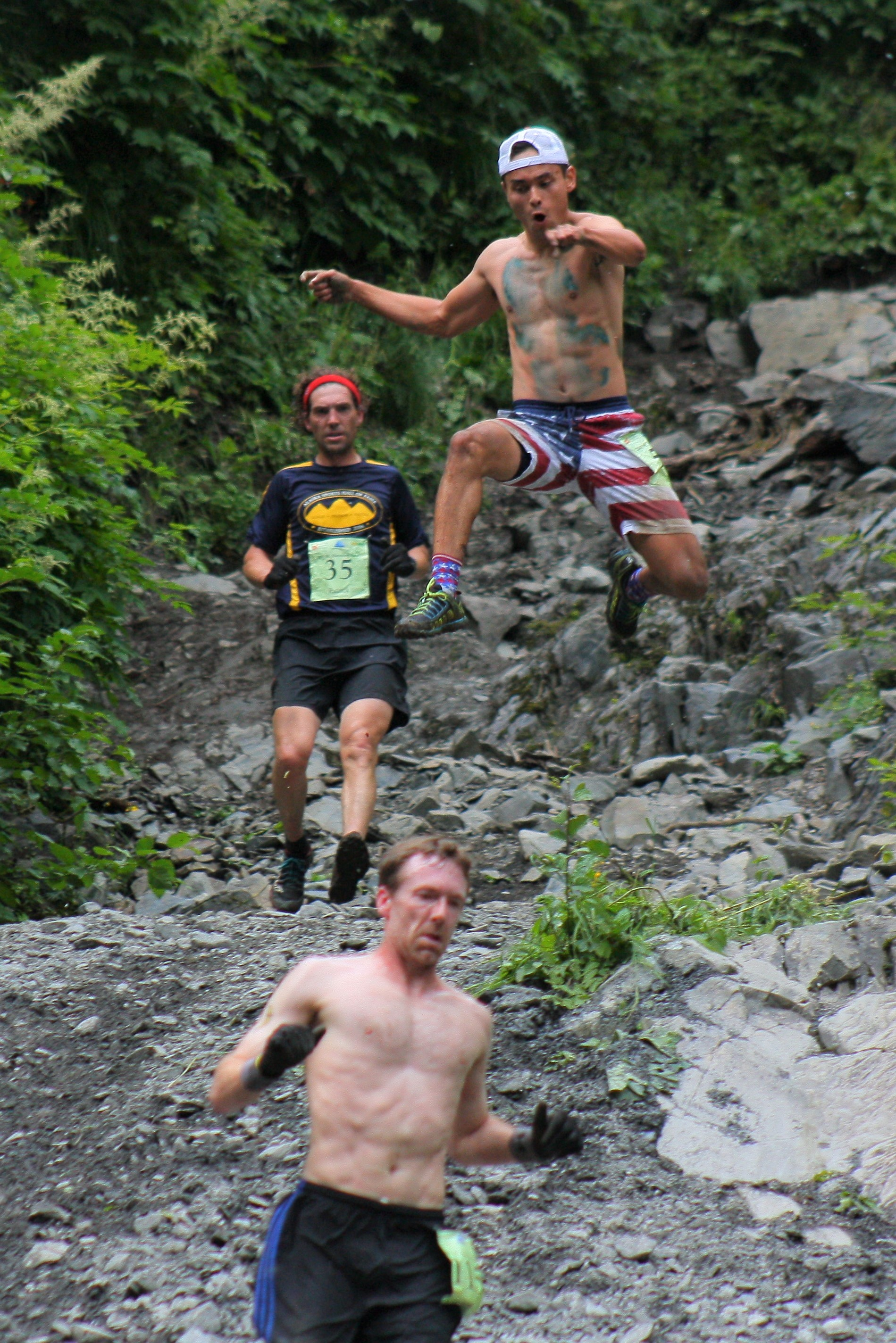 Tadhg Nakada leaps from 'glory rock' during the 2017 Mount Marathon Race on July 4. Nakada finished 38th in the men's division, and was among the many participants who mug for the camera as they come off the mountain every year.