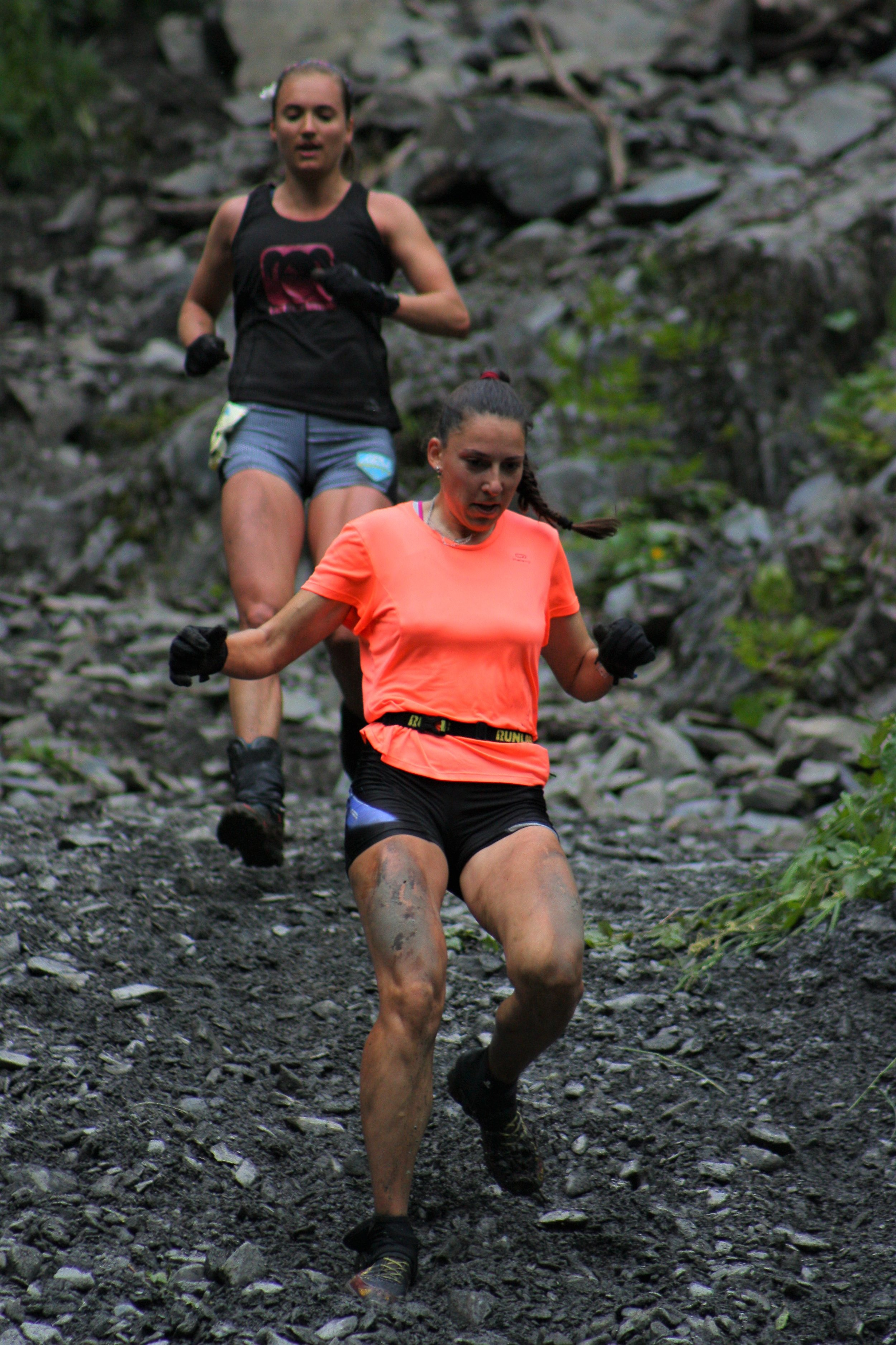 Siberian sky runner Varvara Shikanova emerges from the Mount Marathon trail on July 4 during her first Alaska race, in which she took 13th place, scaling and descending the 3,000-foot mountain in just over an hour. Shikanova was sponsored by U.S. Paralympic skier Andrew Kurka, a graduate of Colony High School, who petitioned the Mount Marathon race committee to allow his Russian friend to participate this year.