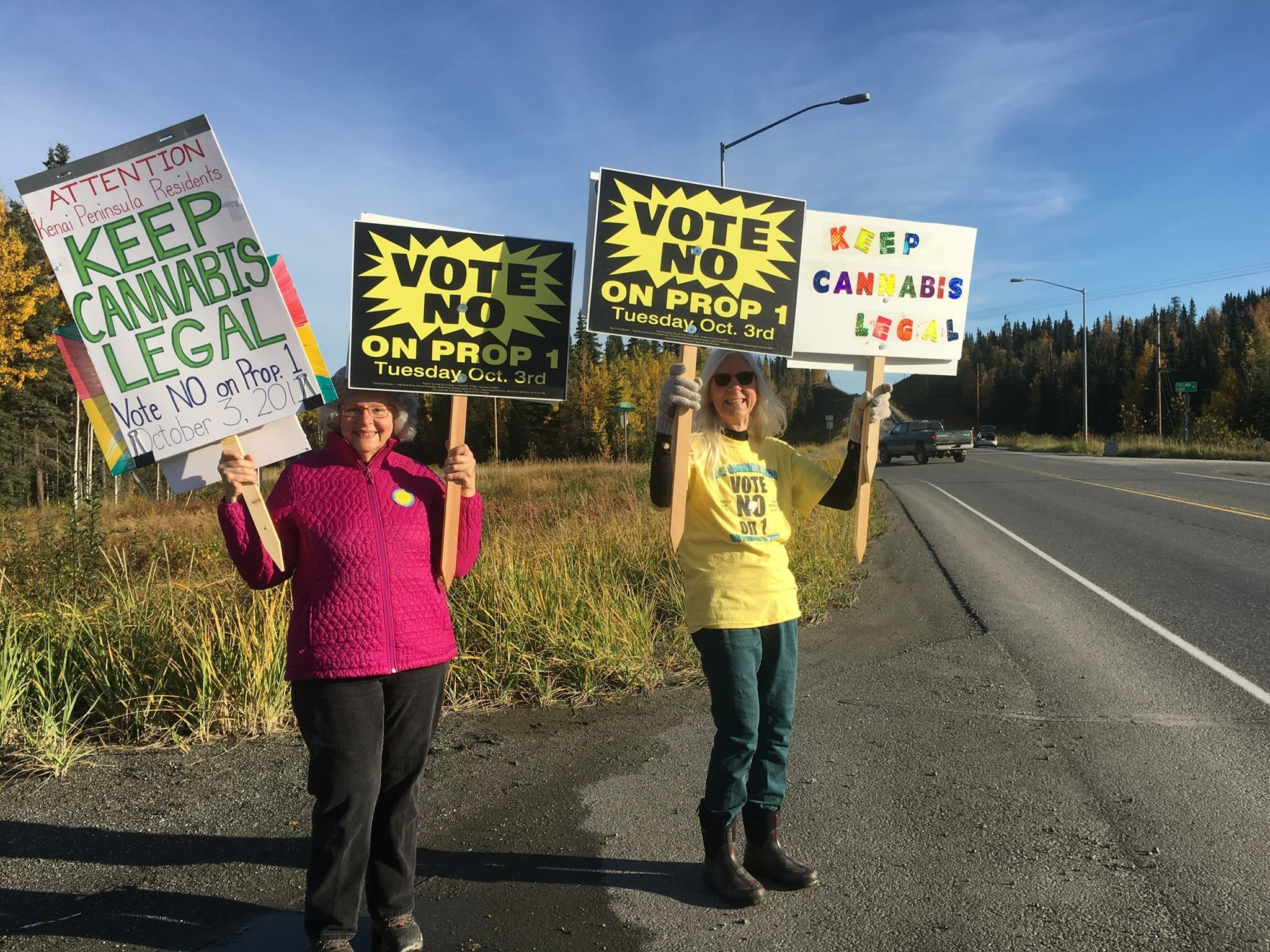 Jan Waldron and Ann Fraser sign waving in Kasilof.