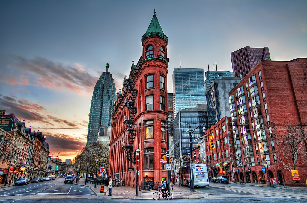 Gooderham Building, Toronto ON – 1892   Also known as the Flatiron Building, the Gooderham Building began construction in 1891. The building, associated with the Gooderham family, was designed by architect David Roberts Jr. It's home to one of the oldest electric elevators in Toronto and it's one of the most photographed historic structures in the city. It only cost $18,000 to build.