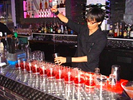 Veteran barman Ivan Chew makes a round of shooters.