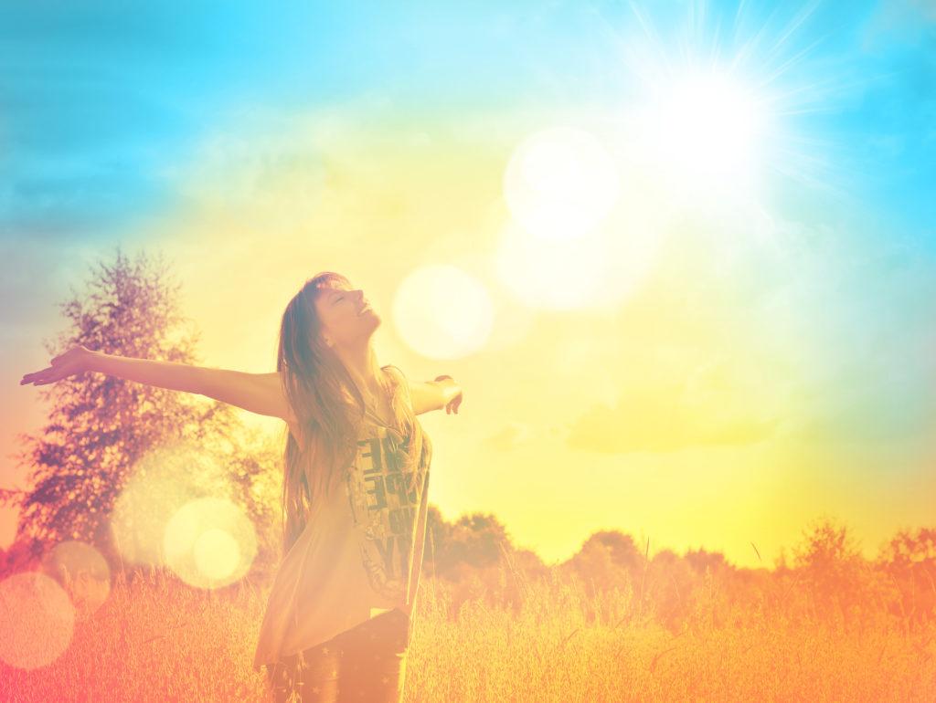 WOMAN-FACING-SUN-IN-FIELD-1024x770.jpg