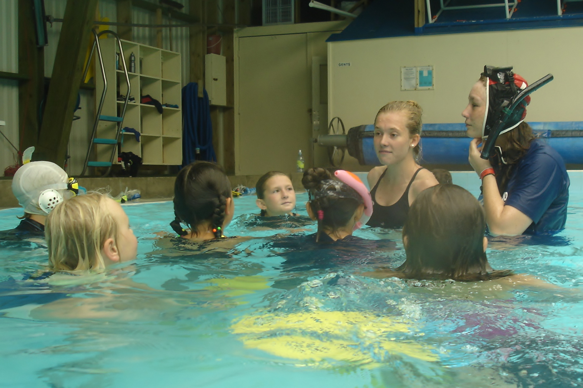 UWH Youth Coaches Sarah Wilson and Jorgia Bayes leading a group of young snorkellers, January 2014