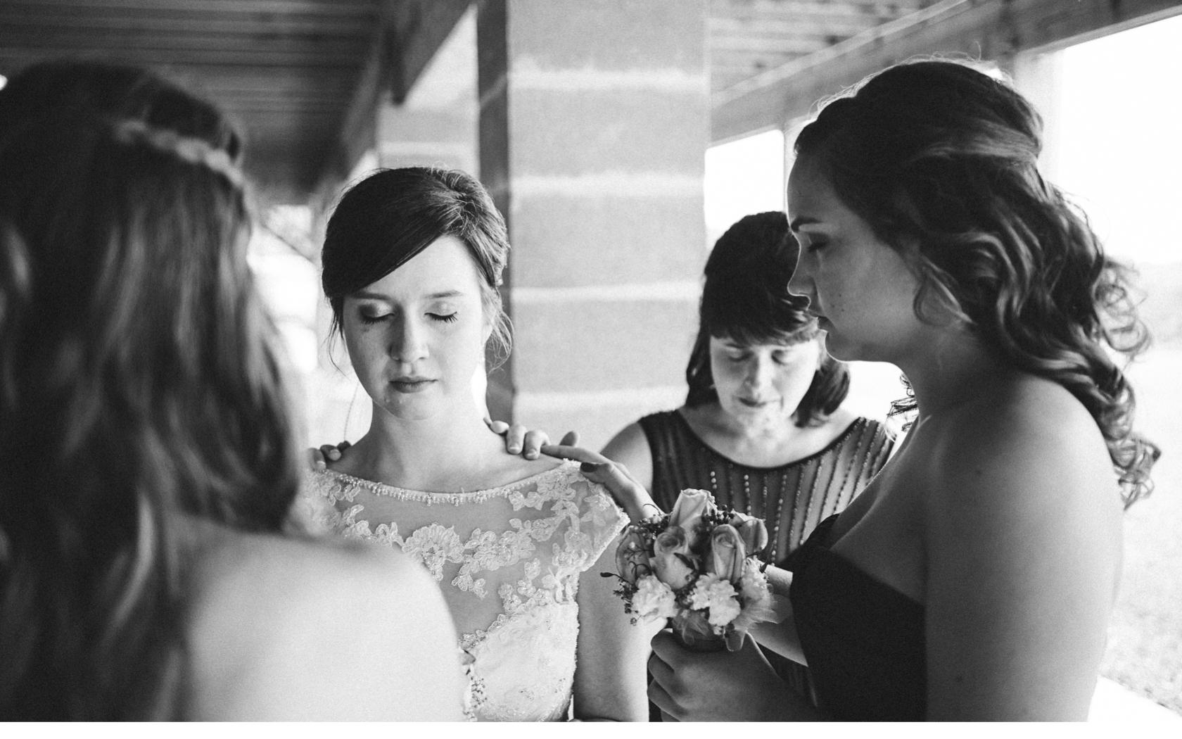 Bridesmaids Praying Before Ceremony