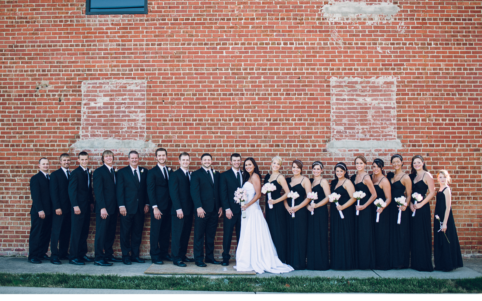 Bridal Party on Brick Wall