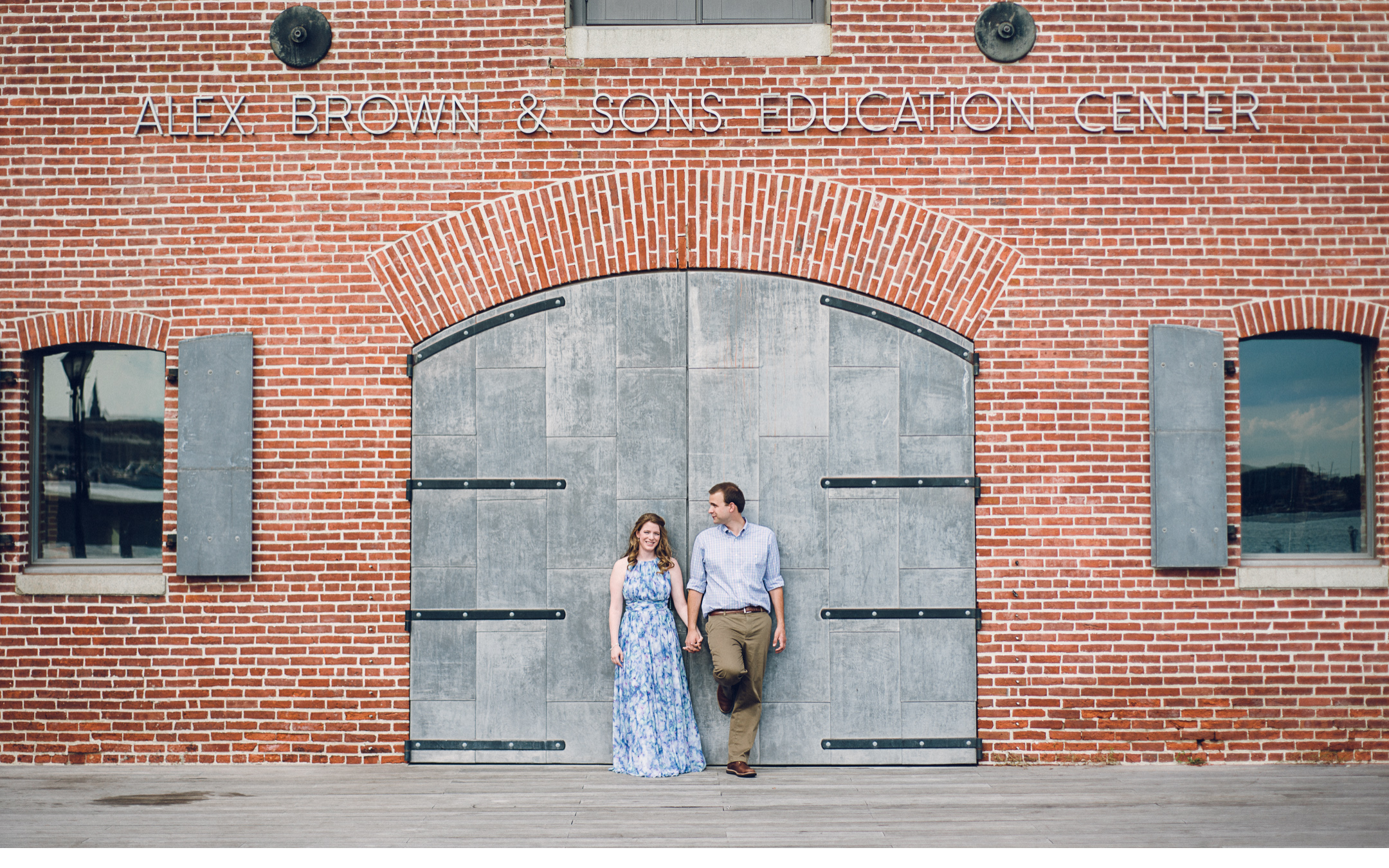 Couple Against Brick Building