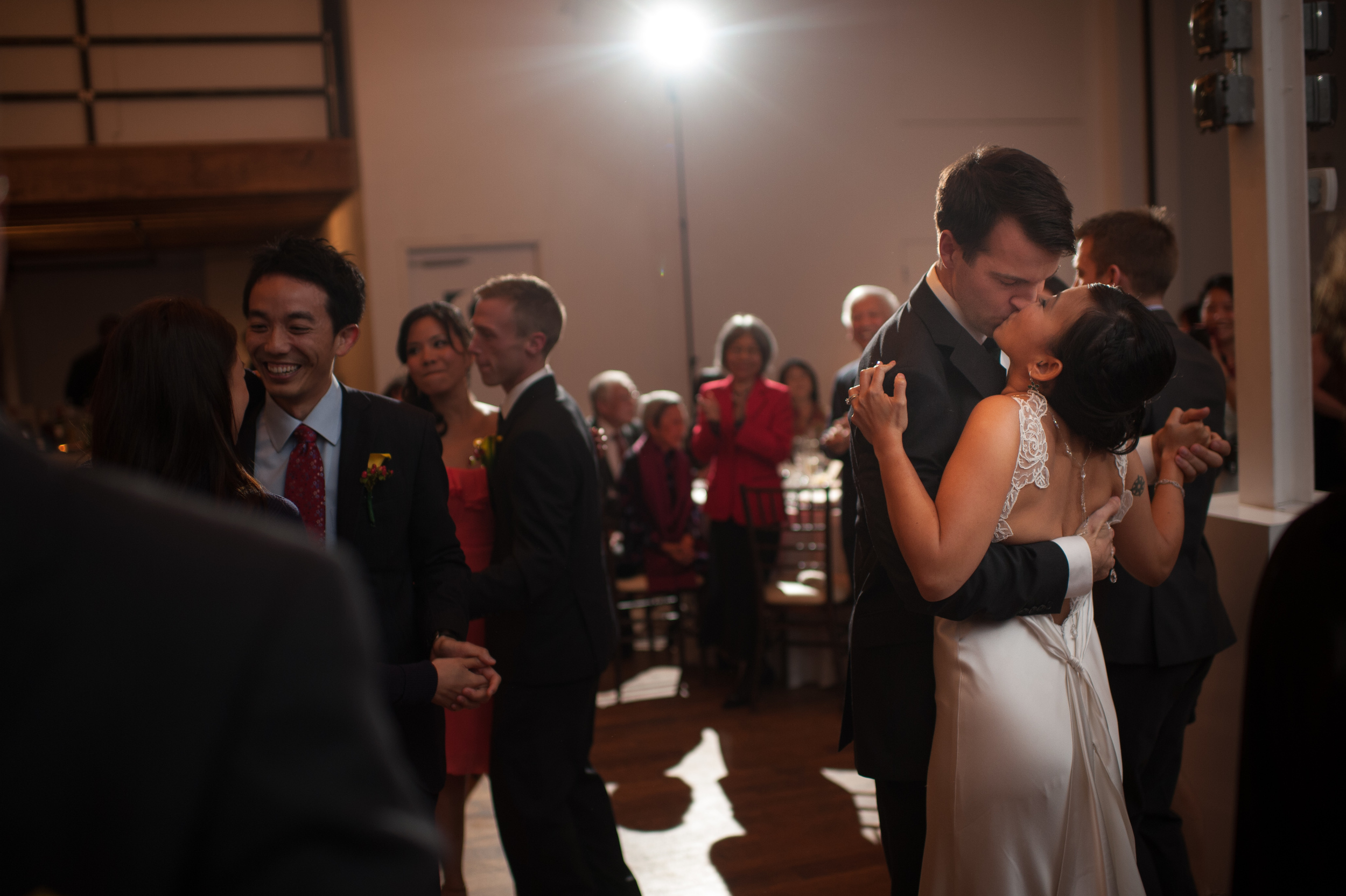 Evelyn + Wayne steal a kiss during their first dance at their wedding reception.