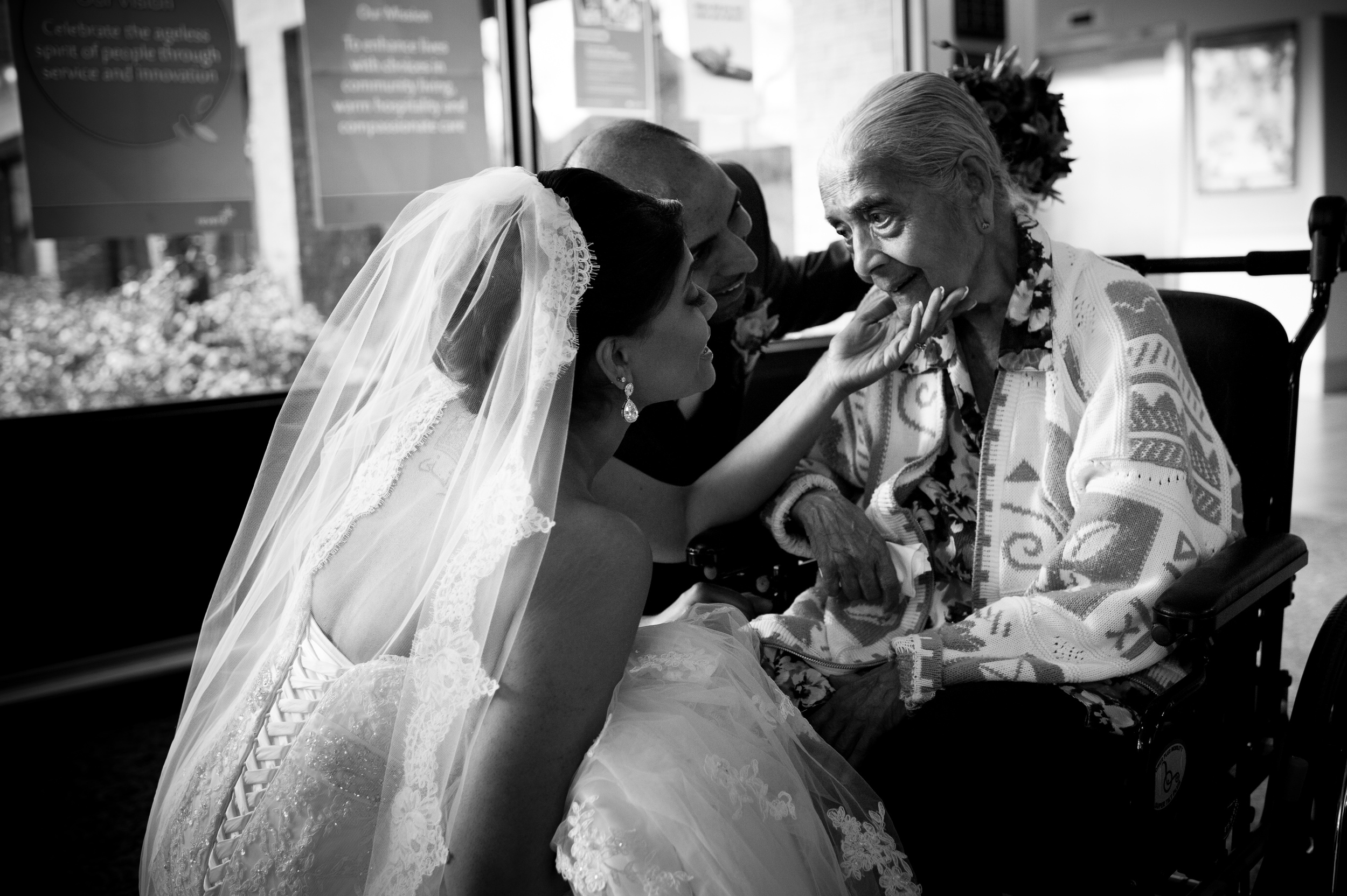 A bride visit's her grandmother in the nursing home immediately after her wedding ceremony.