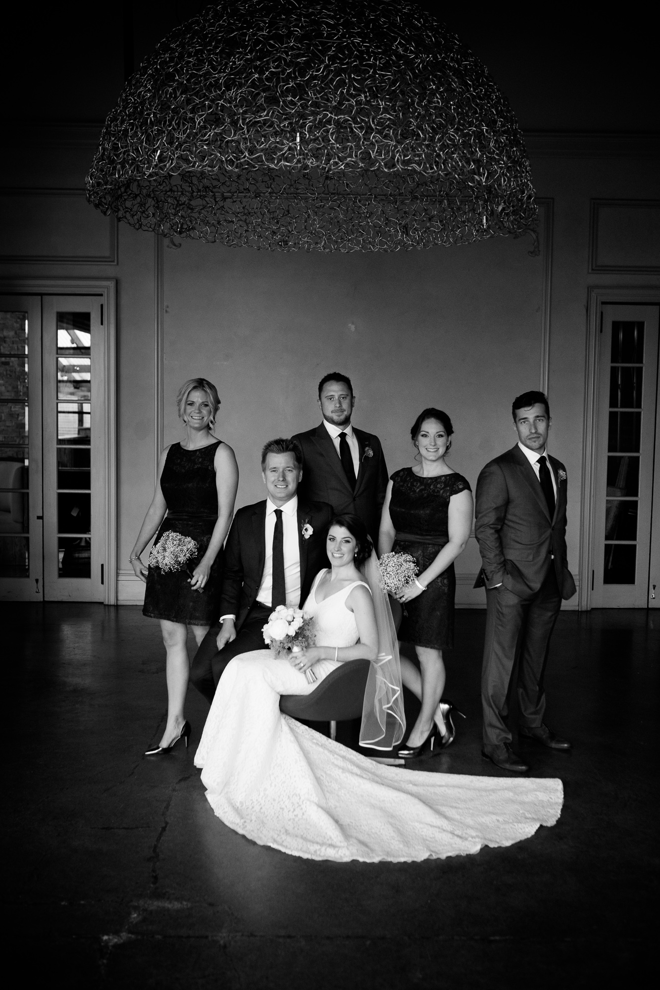 A simple and elegant portrait of the wedding party from Emilie + John's wedding at 99 Sudbury in Toronto.