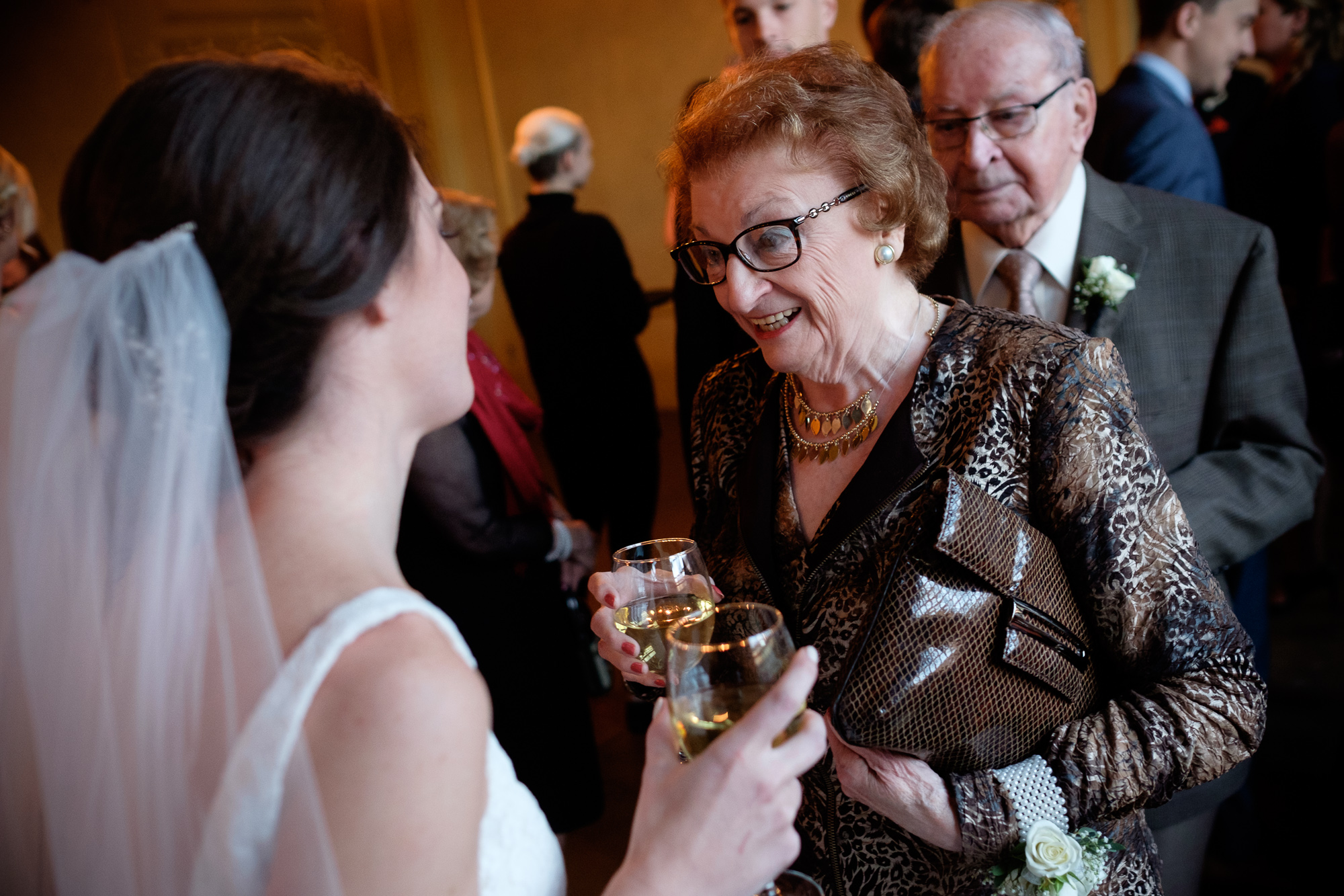 The bride is congratulated by her grandmother shortly after the wedding ceremony at 99 Sudbury in Toronto.