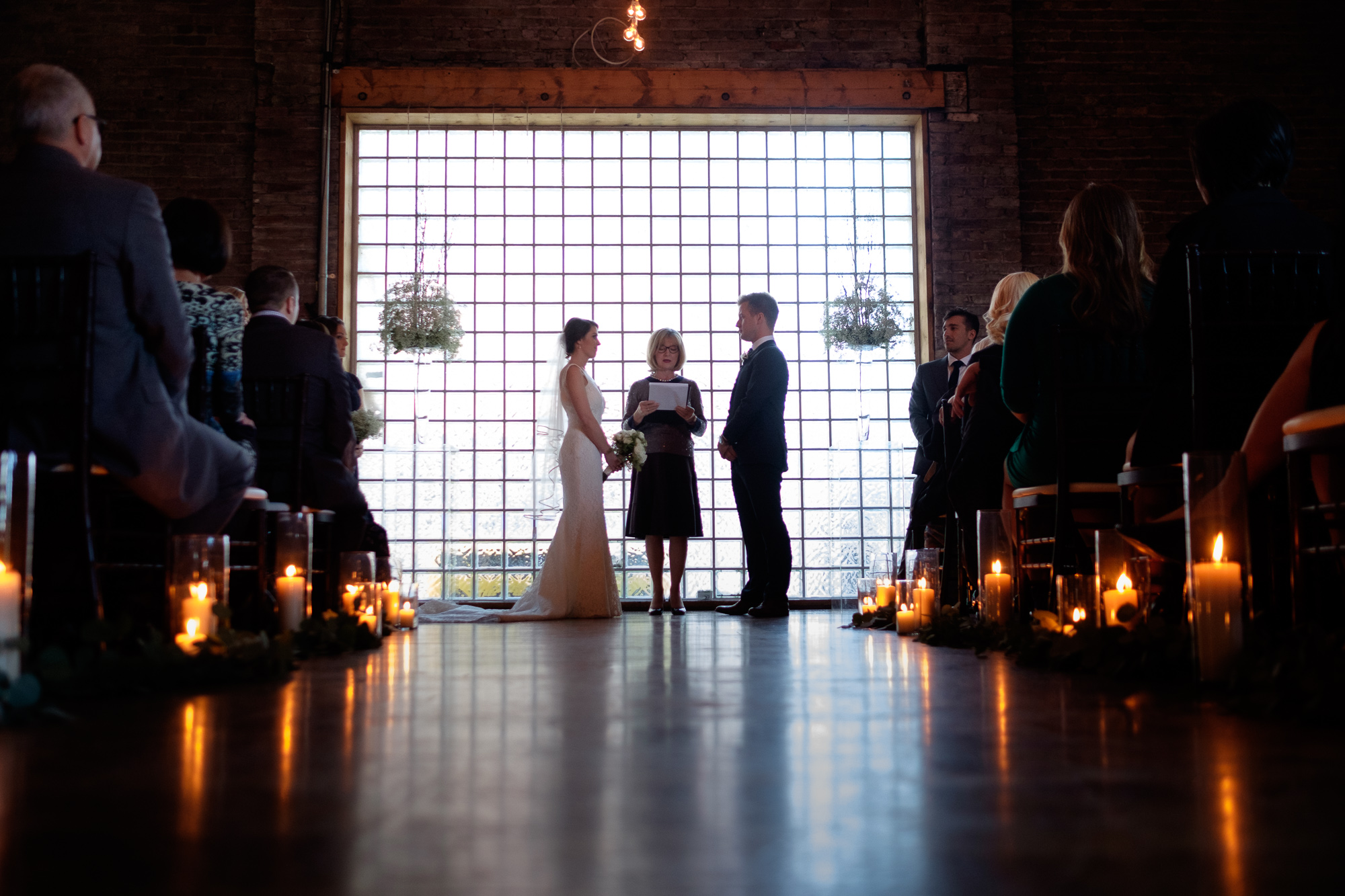 A photograph of the wedding ceremony from Emilie + John's wedding at 99 Sudbury in Toronto.