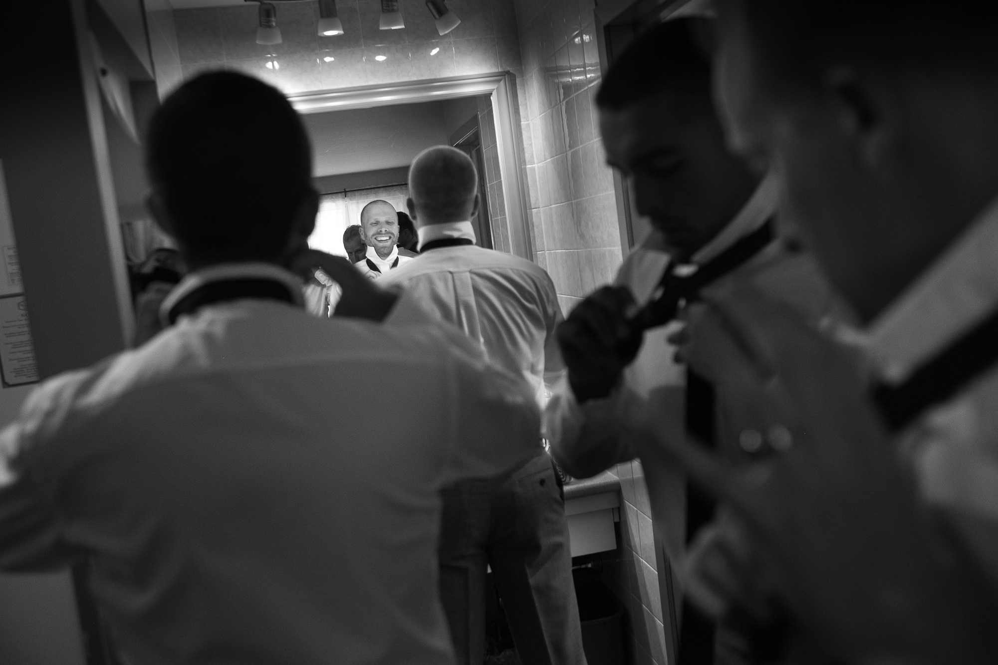 Jeff and his groomsmen get ready in their hotel room at the Hessenland Inn.