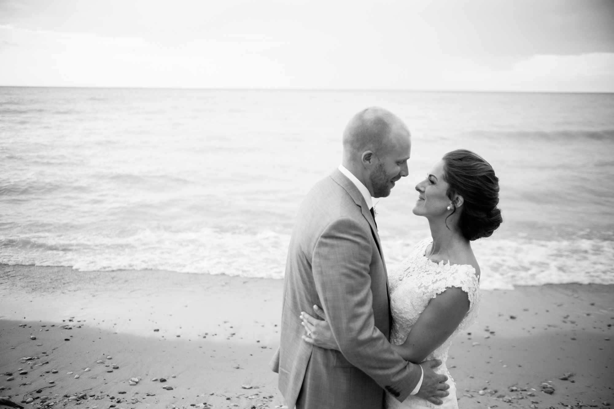 A portrait of Rebecca + Jeff on the shores of Lake Huron at the Hessenland Inn.