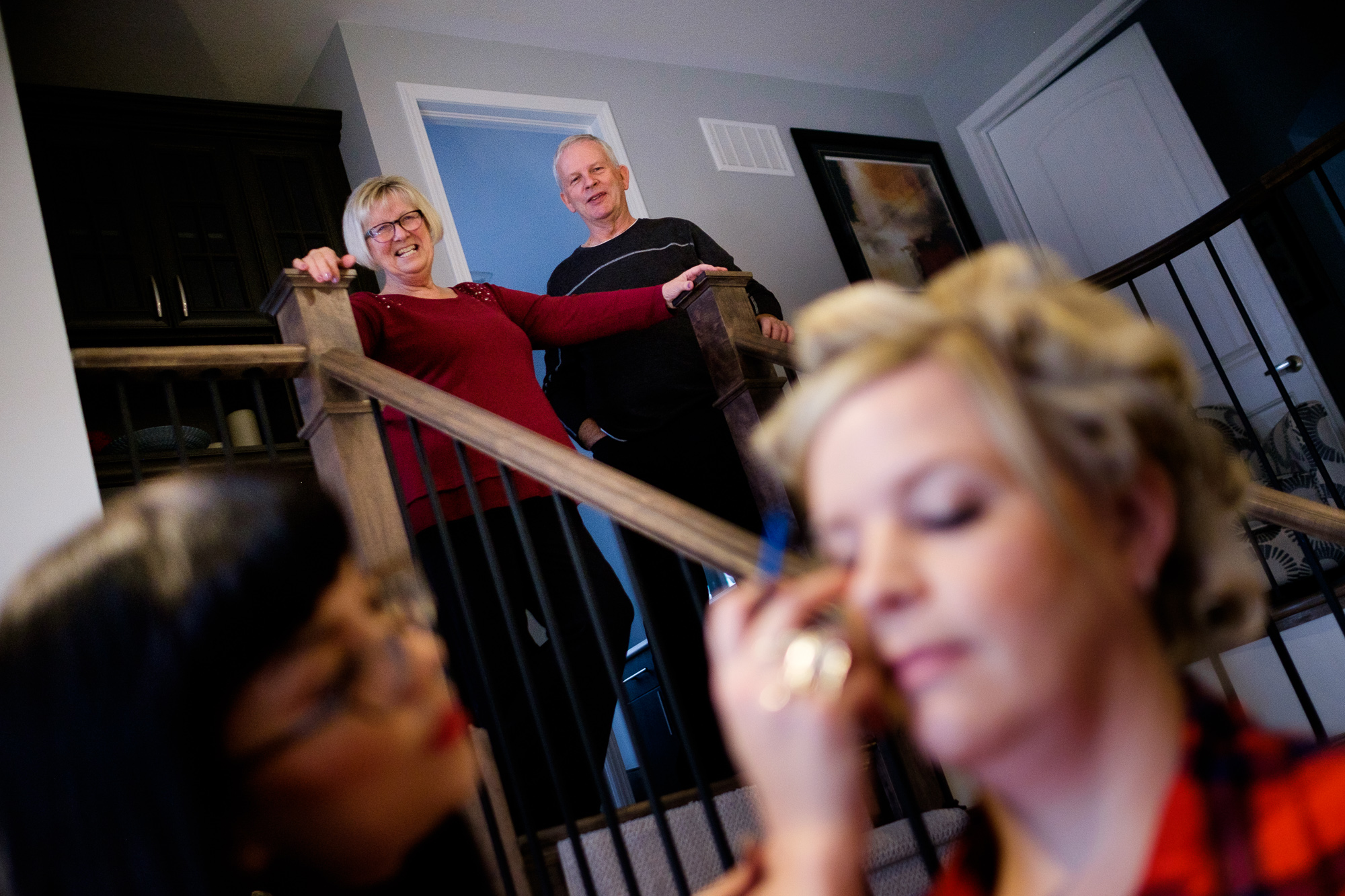 Julia's parents look on as she has her make up done before her wedding at Whistle Bear in Cambridge.