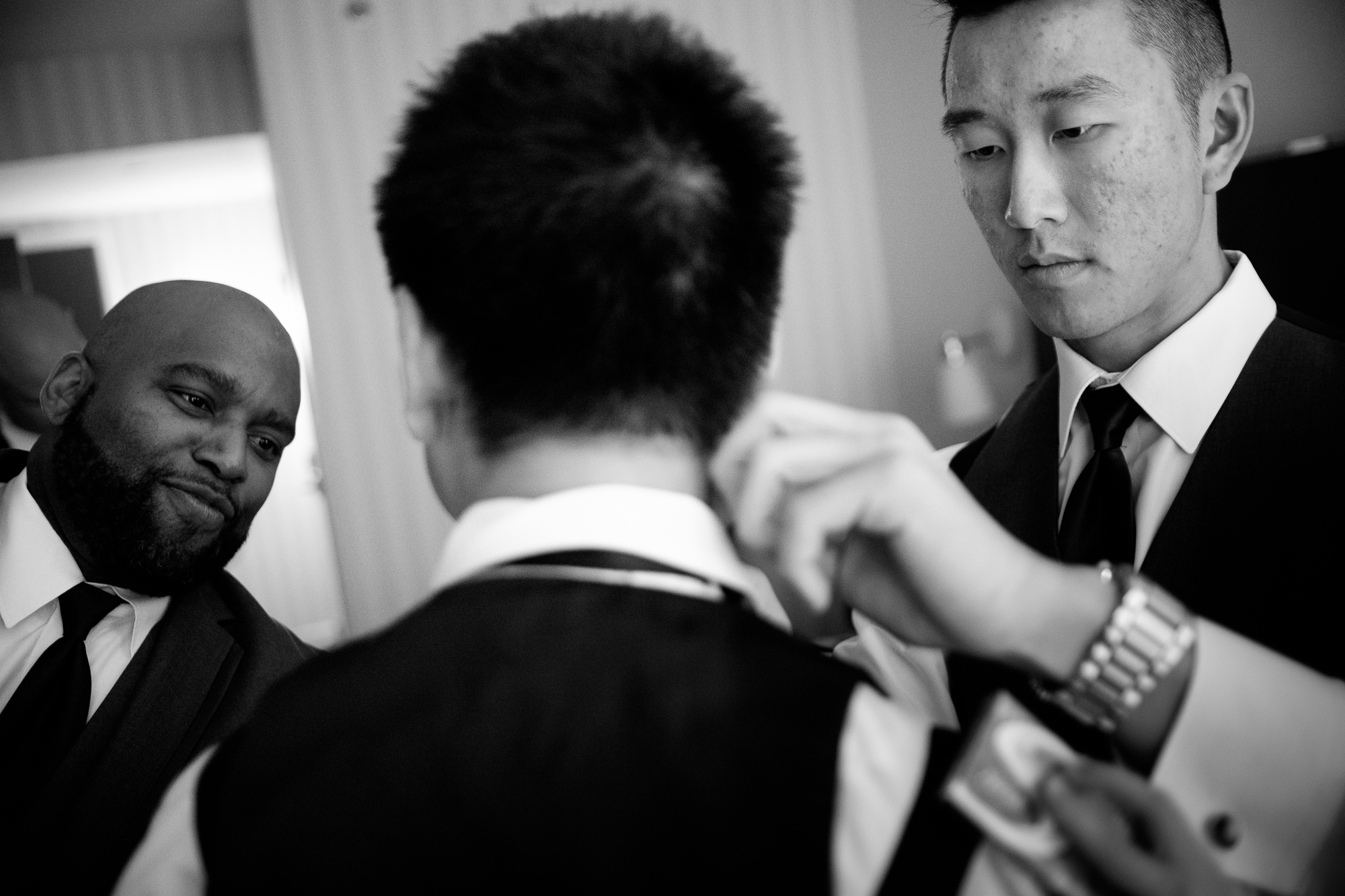 Dan gets help from his groomsmen as he gets ready for his wedding at Whistle Bear.
