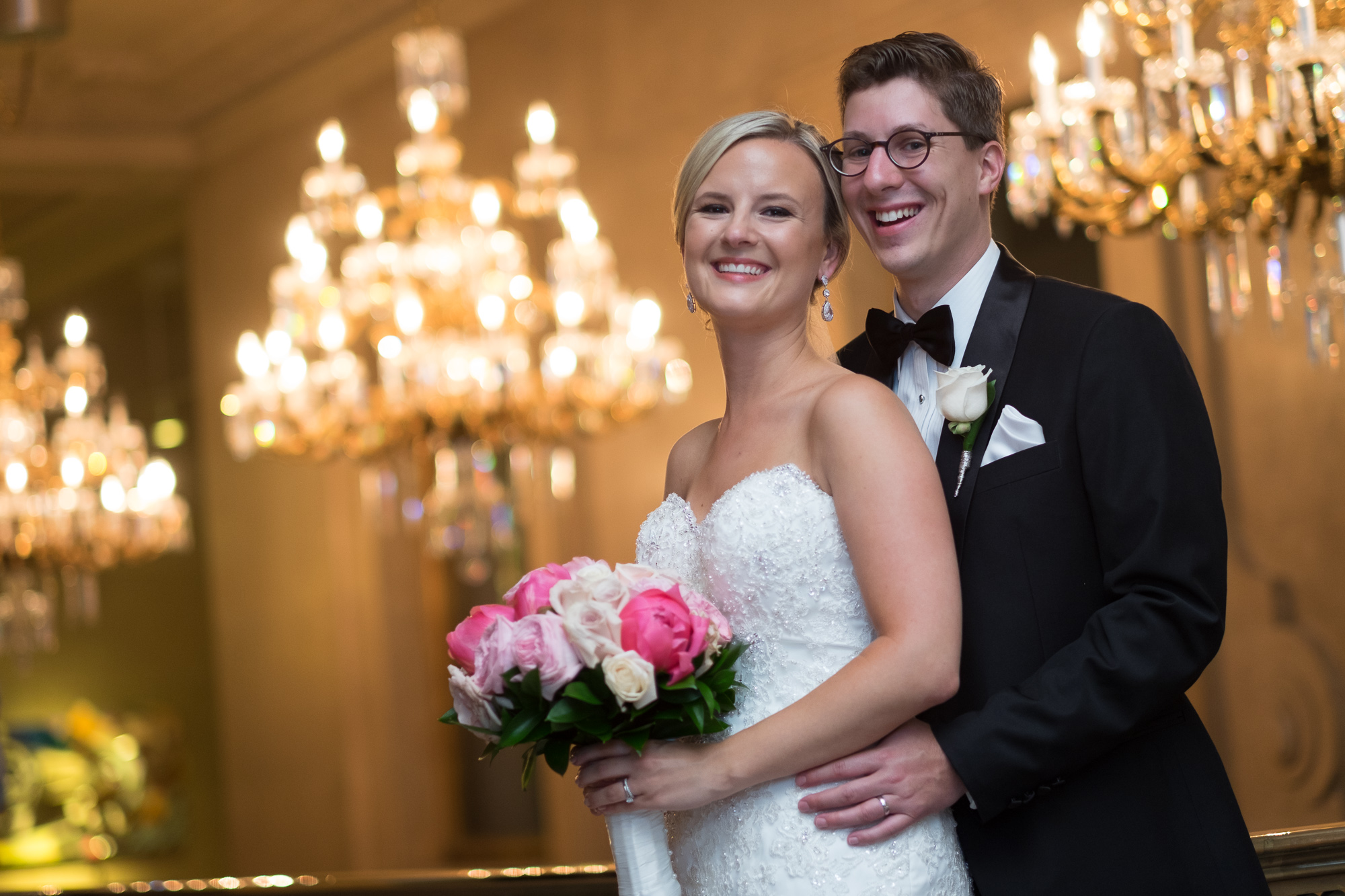 Danielle and Eric pose for a portrait before entering their wedding reception at the One King West Hotel in Toronto.