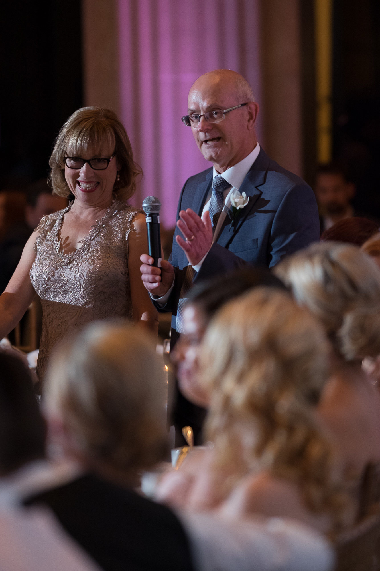 The parents of the bride give the newlywed couple a toast during their reception at One King West Hotel in Toronto.