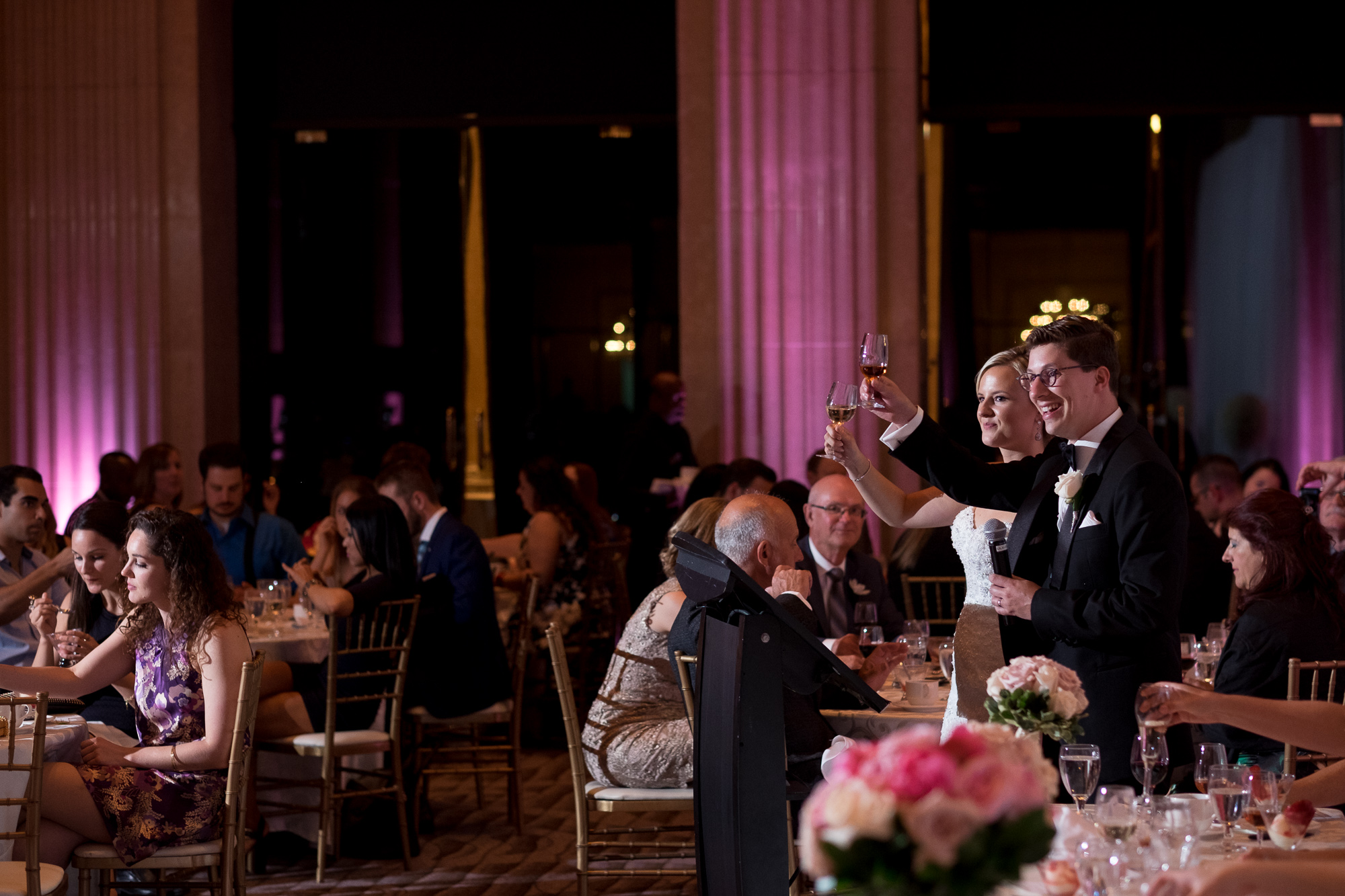 Danielle + Eric toast their guests during their speech at their wedding reception at the One King West Hotel in Toronto.