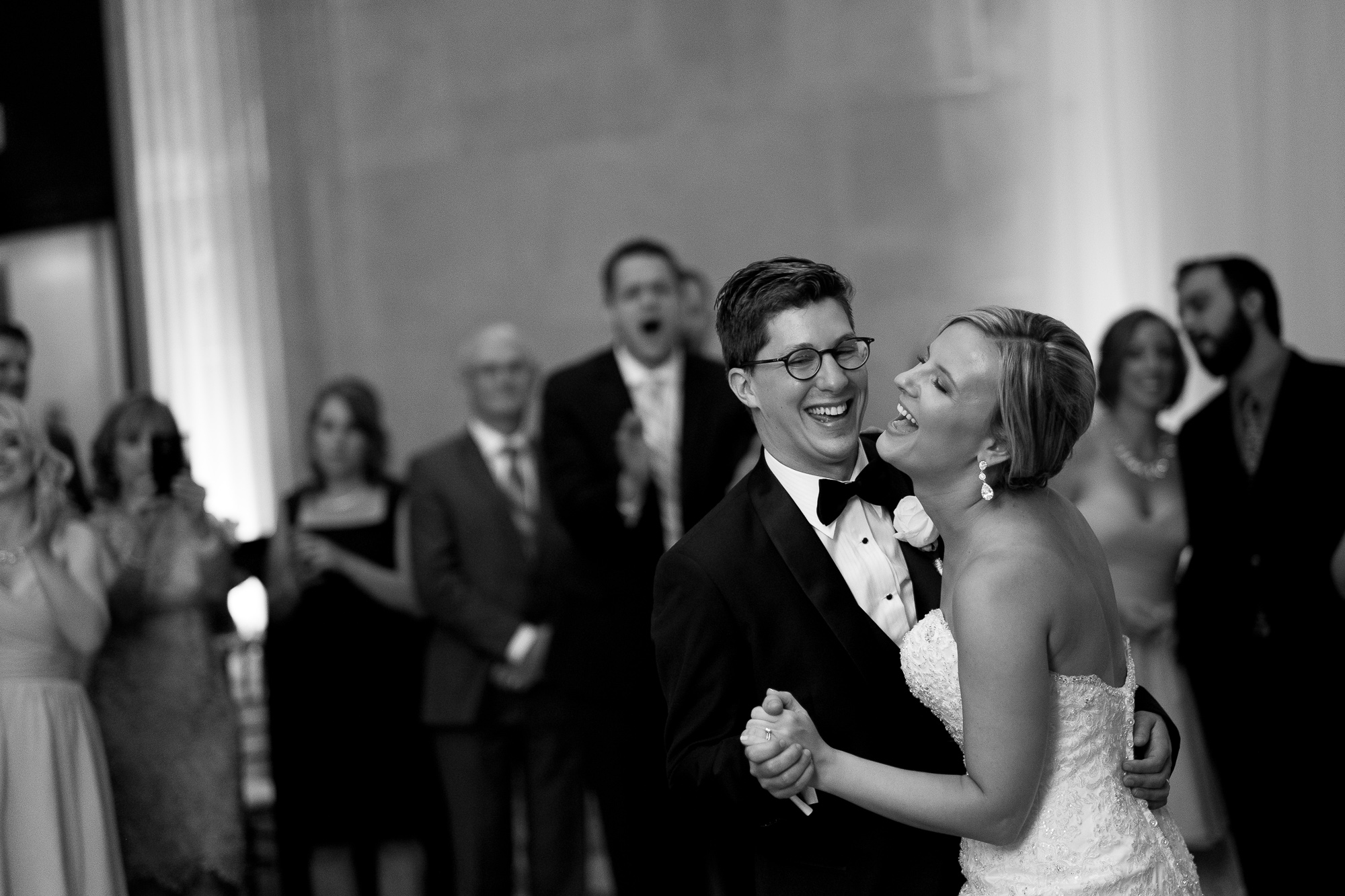 Danielle + Eric share a laugh during their first dance as a married couple at their One King West Hotel reception.