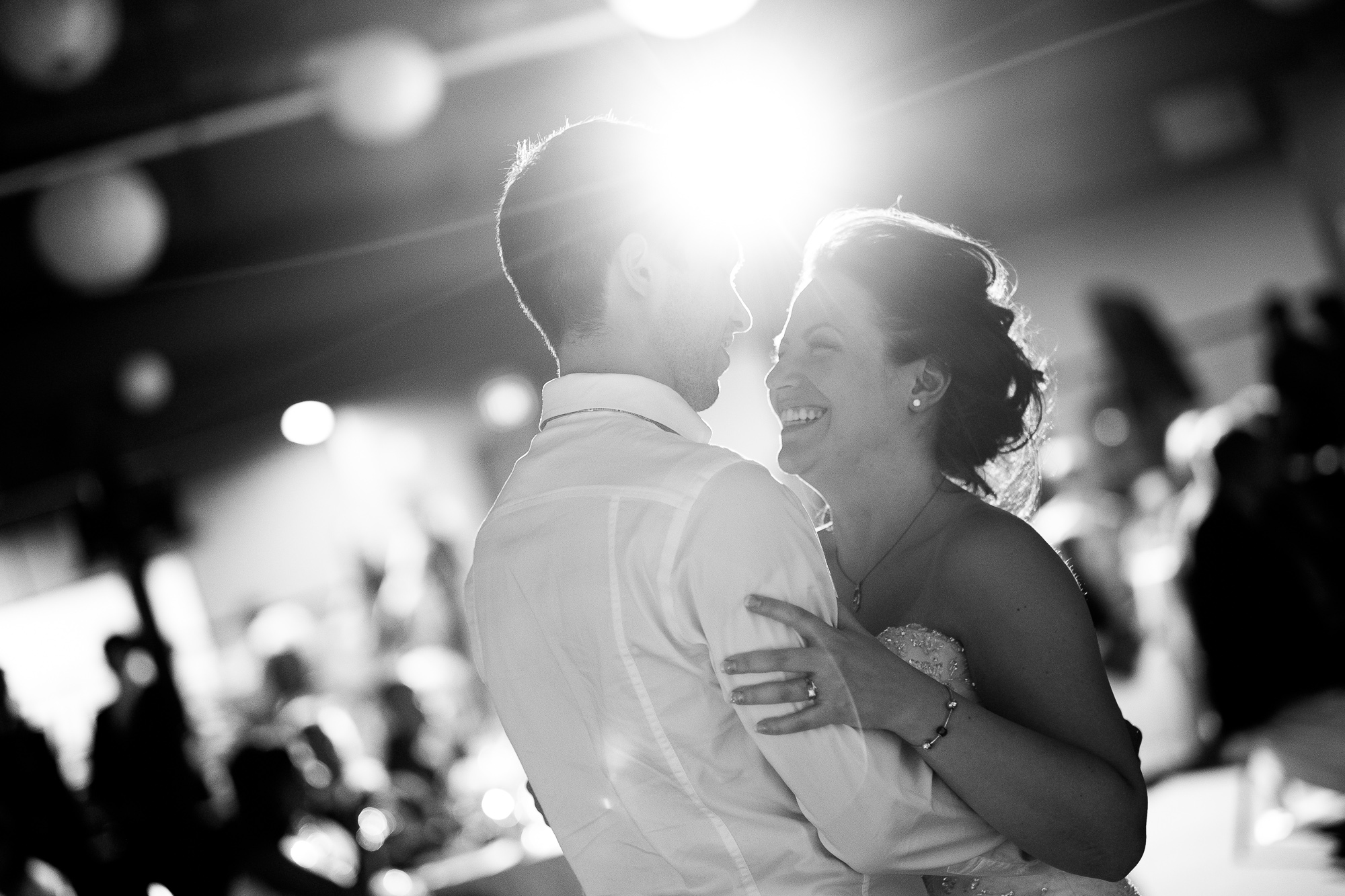 I love it when people are smiling in wedding photographs (I'll take happy crying as well) so obviously I love this picture from Kaylen and Roberts wedding this spring at Federation Hall in Waterloo.  You can see the joy on Kaylen's face as she enjoys their first dance during the wedding reception.