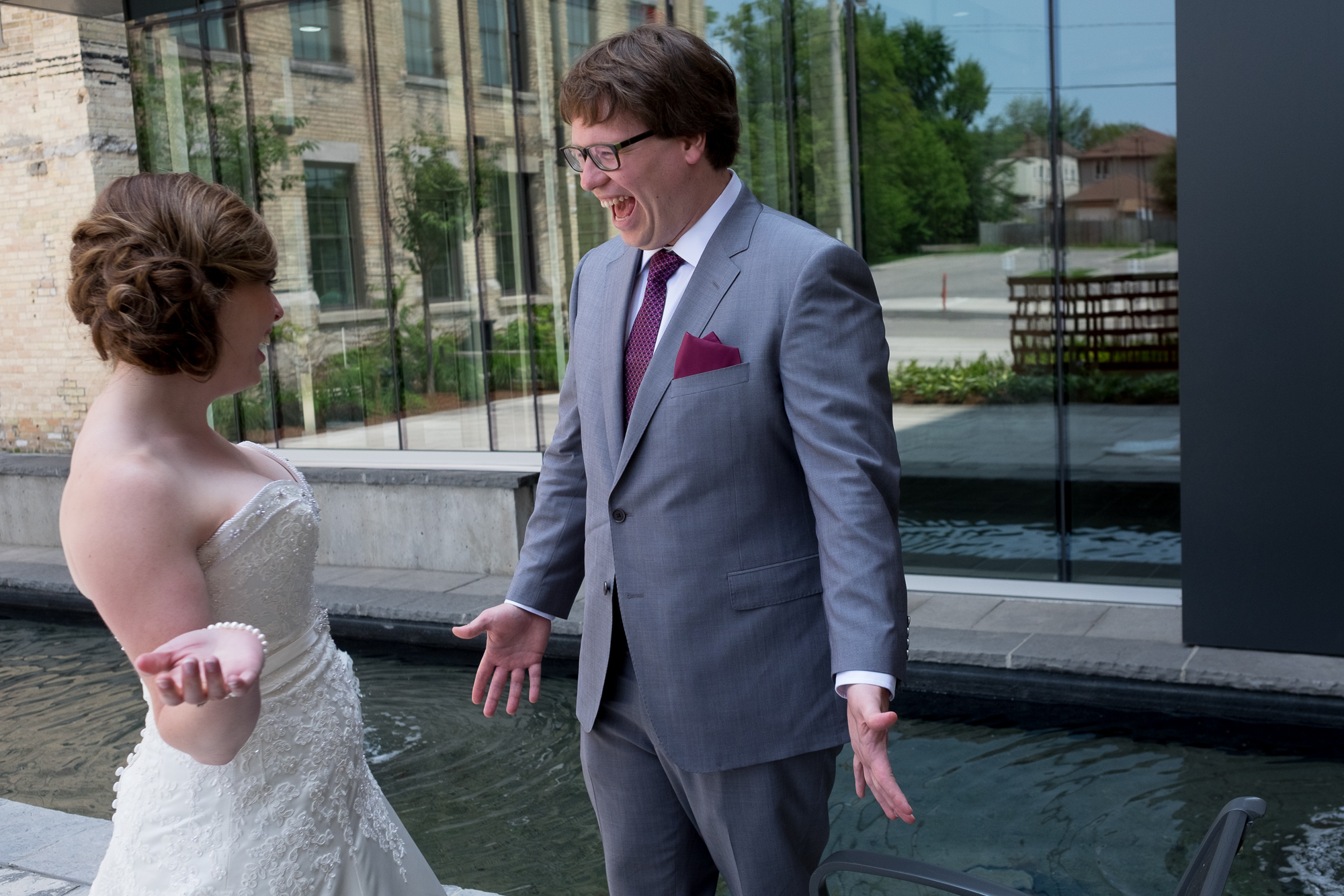 Ian reacts to seeing Jennifer for the first time during their first look before their wedding in Waterloo.