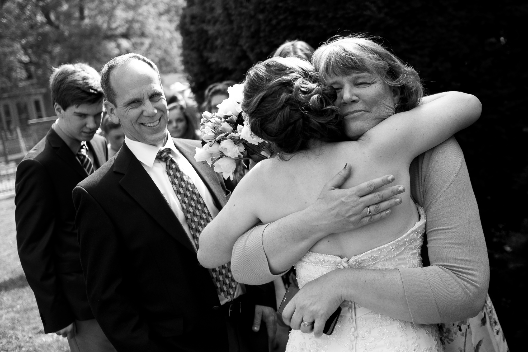 Jennifer greets friends and family after their wedding ceremony.