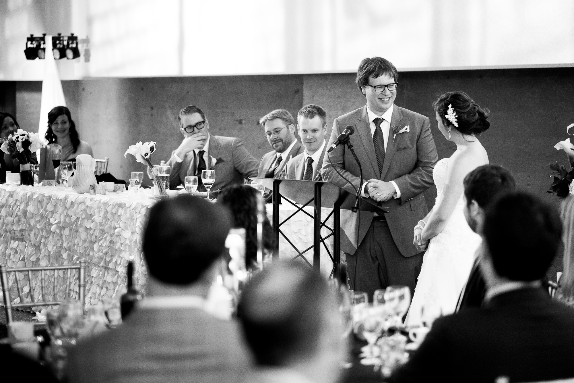 During the wedding reception, Ian toasts his new bride in his speech.