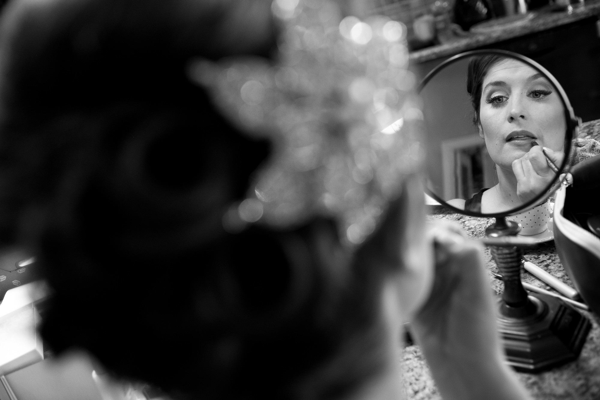 Joanna adjusts her make up before putting her wedding dress on before her wedding ceremony.