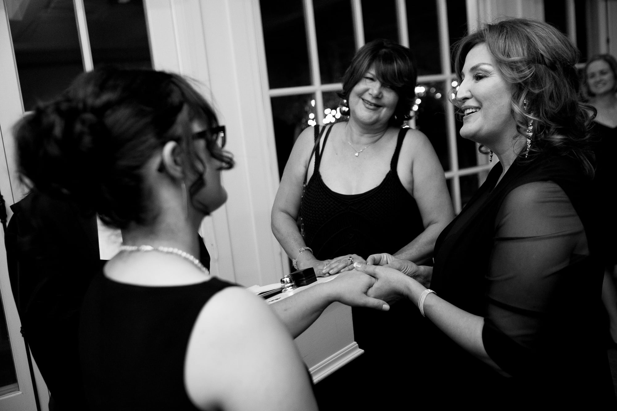 Renee + Senem exchange vows during their wedding ceremony at Langdon Hall.
