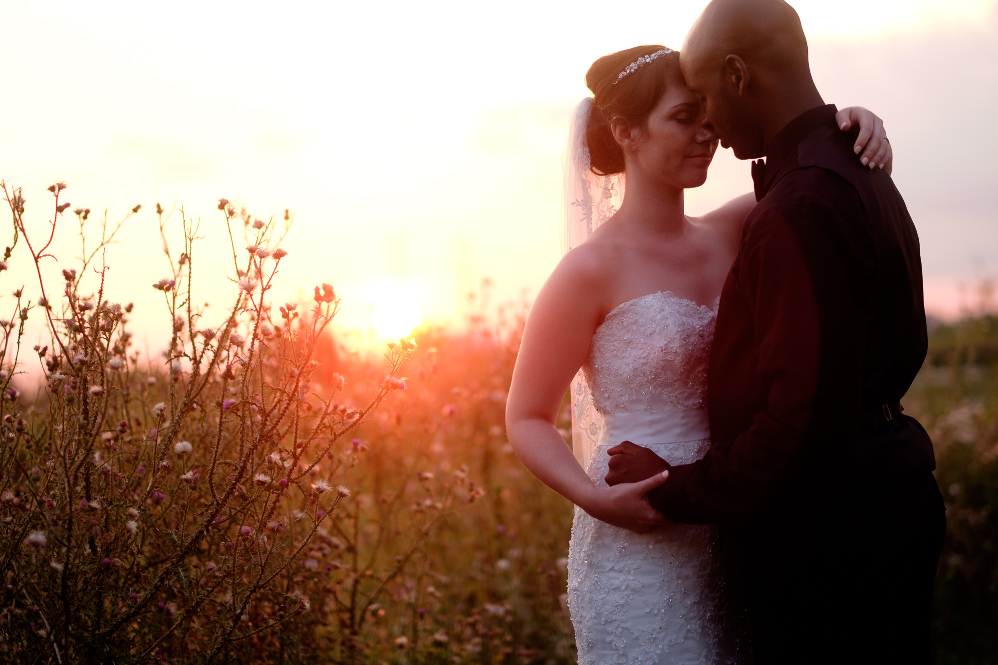 Jennifer and Alex pose for a wedding portrait during sunset at their Toronto Wedding.