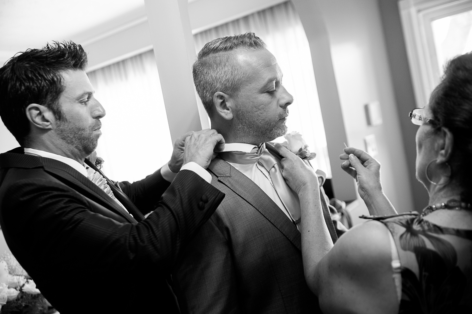 Theo and his mom help the best man getting ready before their Toronto wedding.