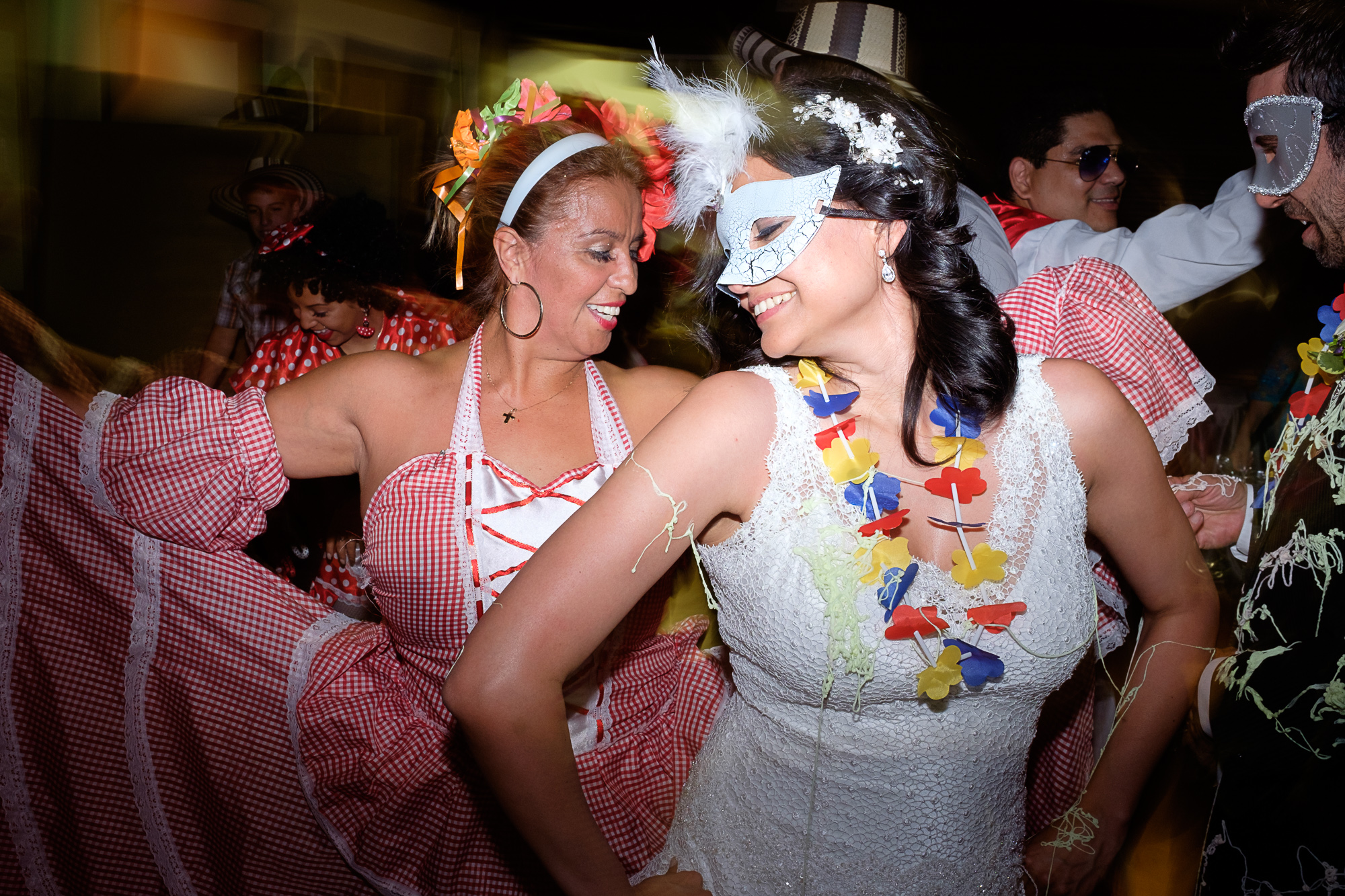 Maria dances with a member of a Columbian dance troop who helped open up the dance floor at their Toronto wedding reception.