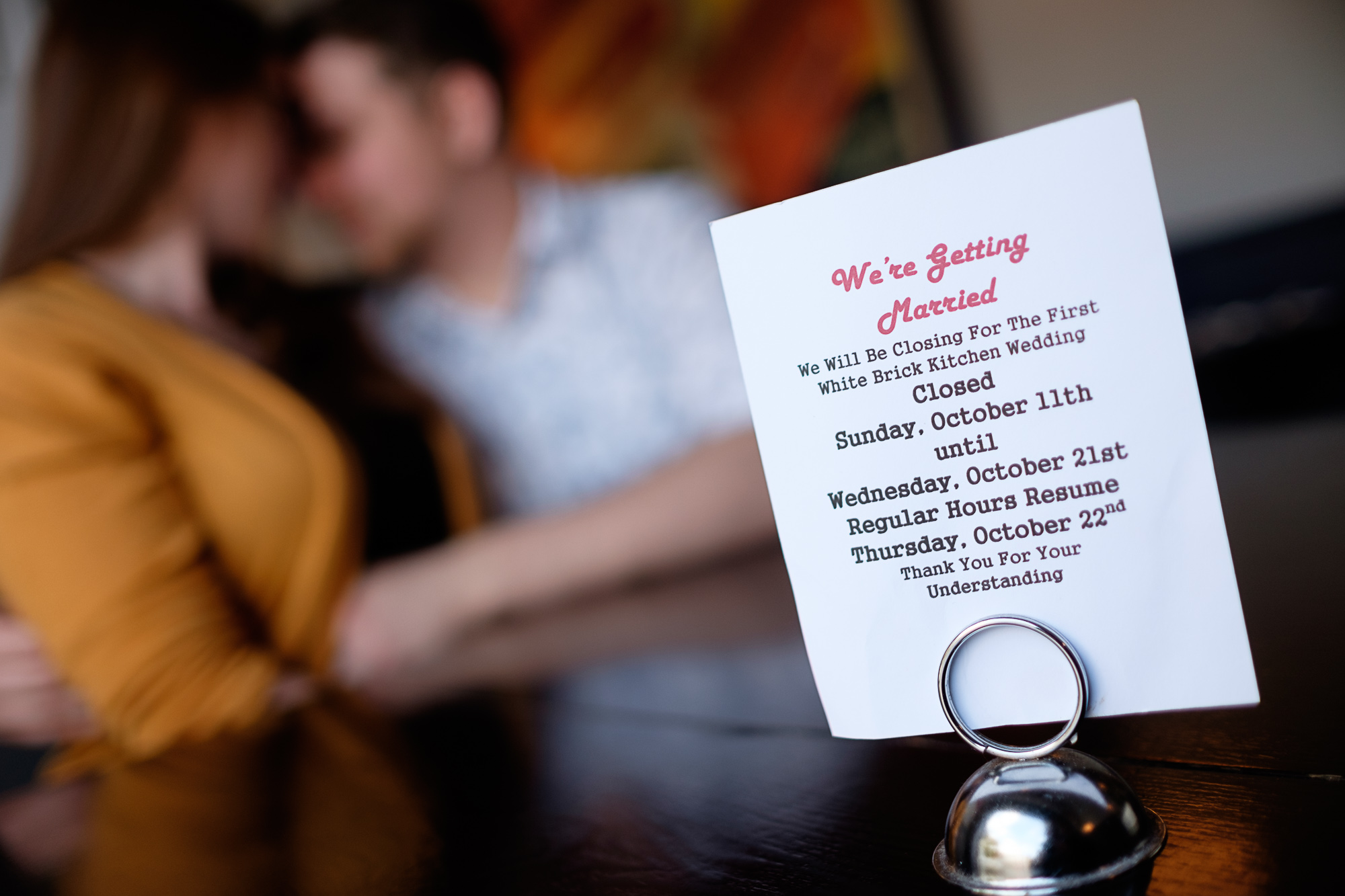 An engagement photograph from Haley + Stephen's engagement pictures in their restaurant in Toronto.