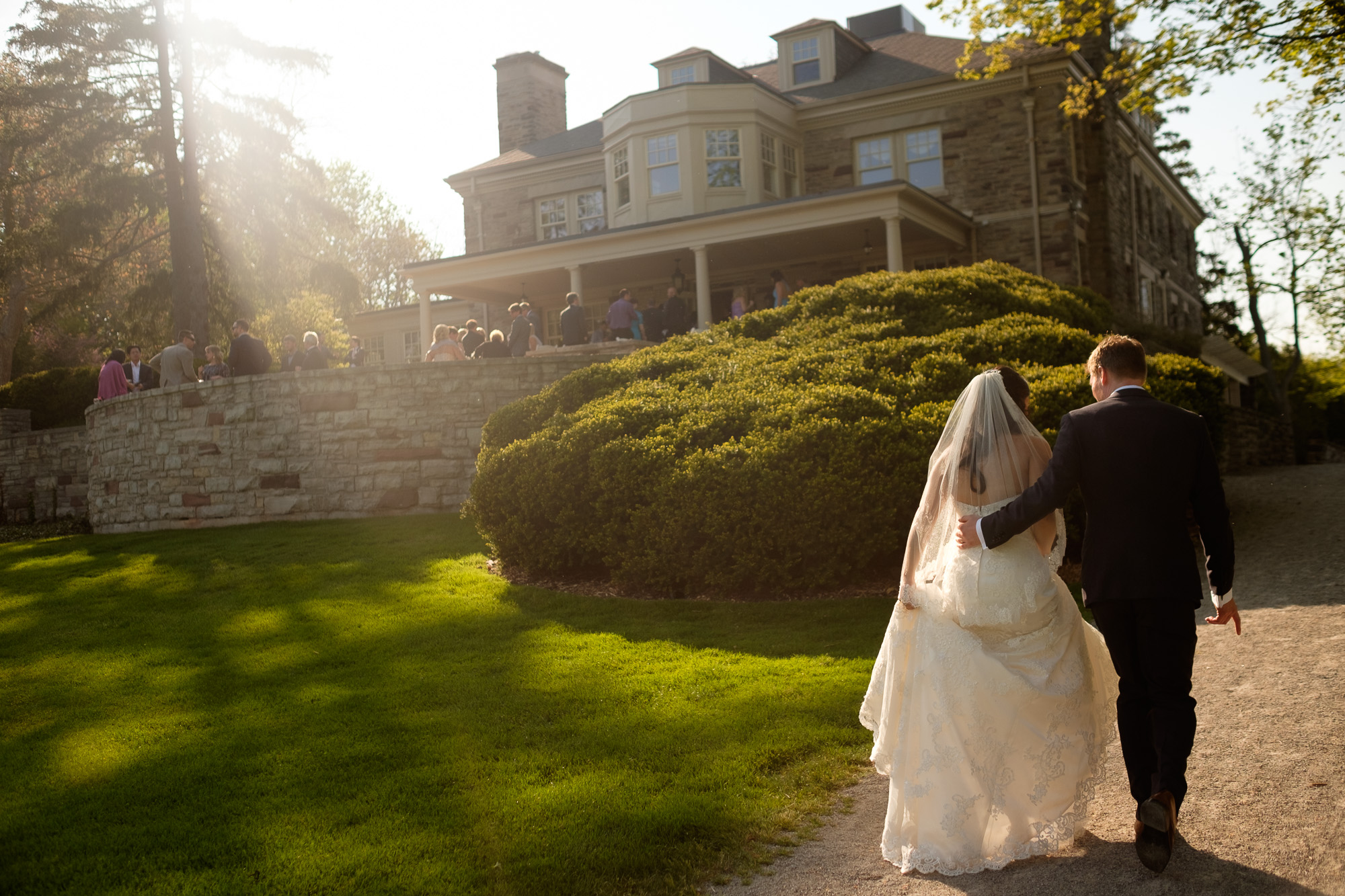 A wedding photograph of the bride and groom as the walk back to their reception at the Paletta Mansion in Mississauga.