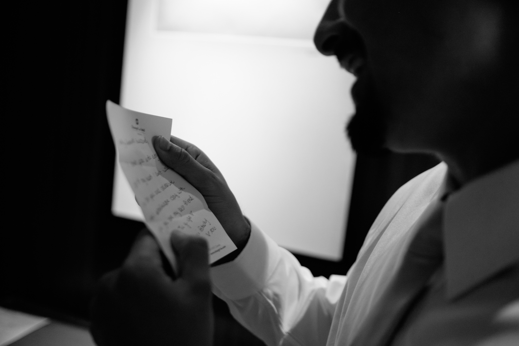 Felipe reads a note from his bride before their wedding at the Fermenting Cellar.